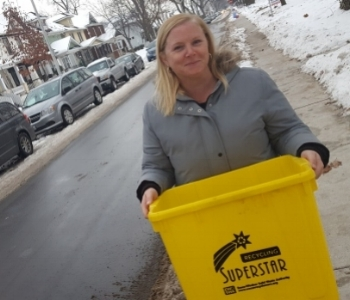 - School teacher Jennifer Daley Stewart became one of about 100 residents to receive the new gold-star recycling bins awarded to impeccable recyclers. Source: CBCNews Windsor (Robert Stewart)