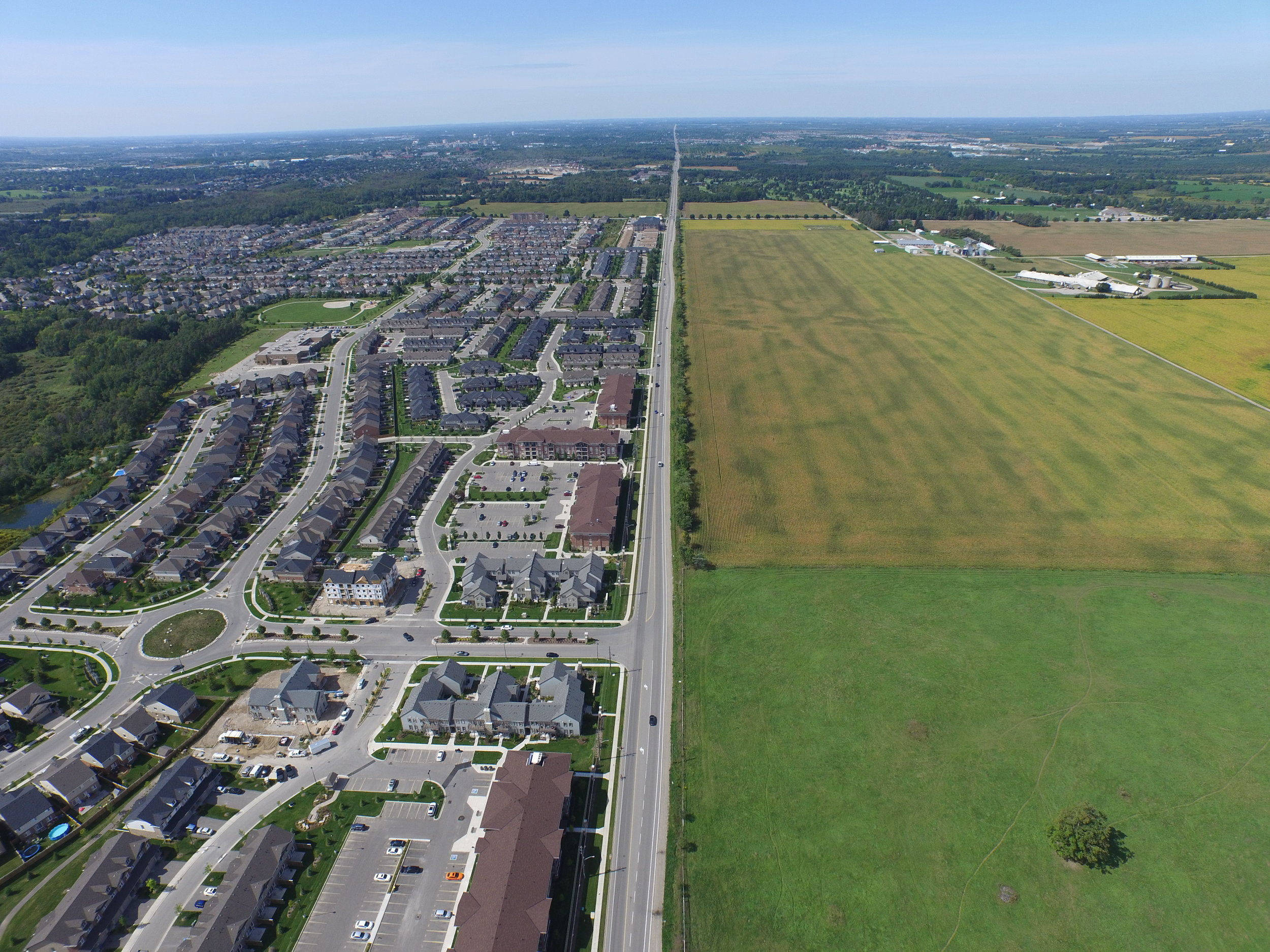 """Aerial view of """"Urban Sprawl"""" in the famous Greater Golden Horseshoe area of Ontario, where farmland has already been paved over for unsustainable low-density sprawl development and up to 31,000 acres of more farmland areas are at immediate risk   Source:  OntarioFarmlandTrust.ca"""
