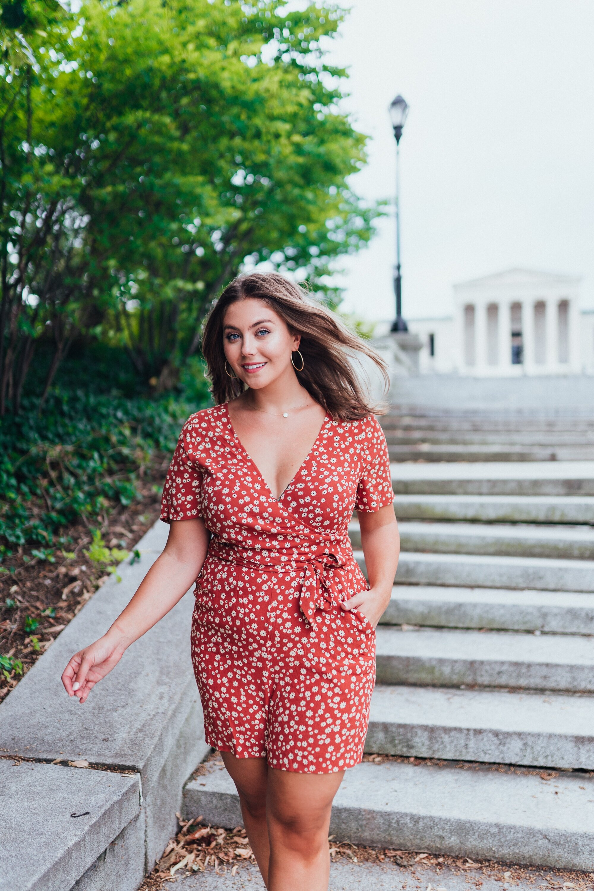 Another favorite place to shoot, Delaware Park with Albright Knox Art Gallery in the background   ROMPER   , wearing size 14