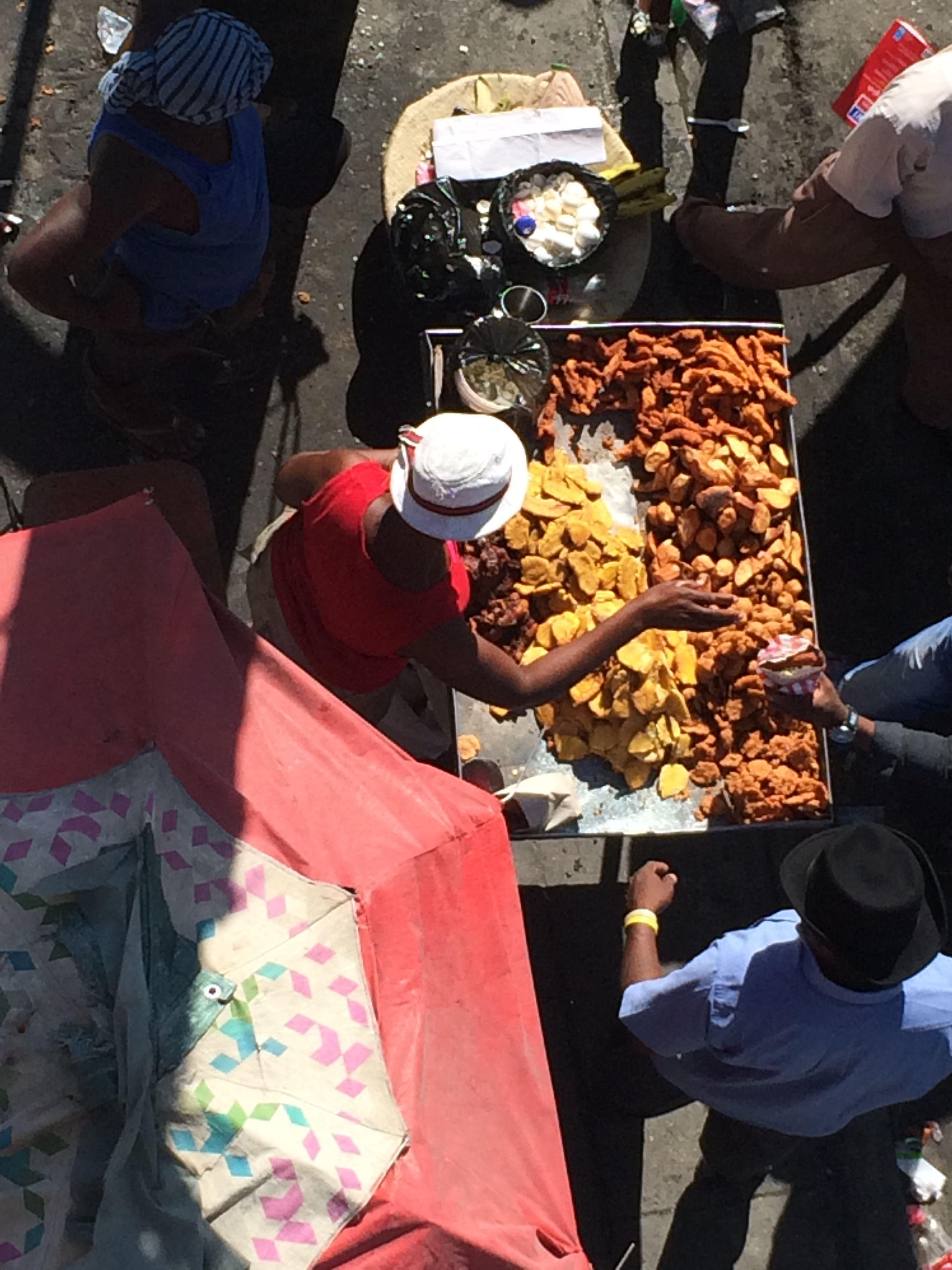 A local woman selling plantains and fried chicken. Many of the businesses that provide financial security for the families and communities are similar to this. They are often pop up businesses that are portable, and do not rely on a brick and mortar base