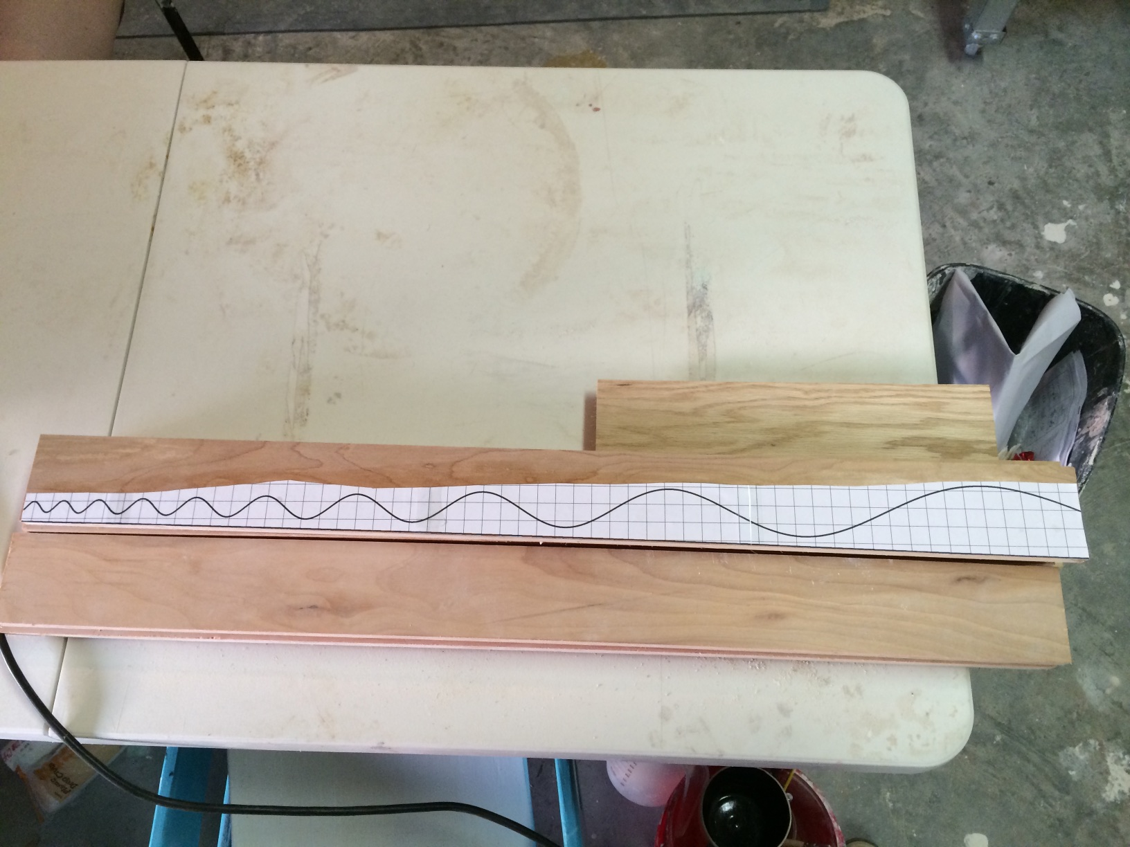 Cut out and stick pattern onto wood strips using adhesive spray.