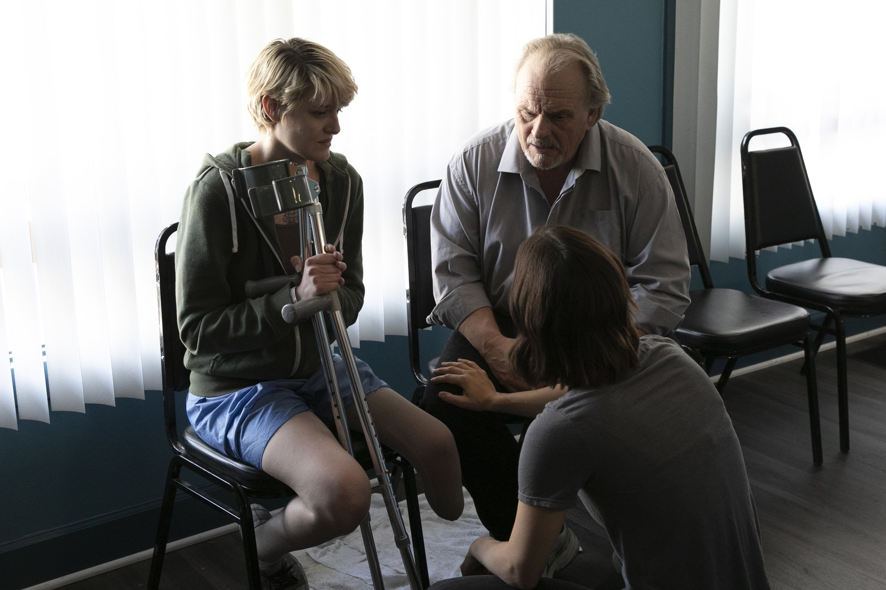 Katherine Kampo (Young Vet) and Robert Craighead discussing the upcoming scene with the director.