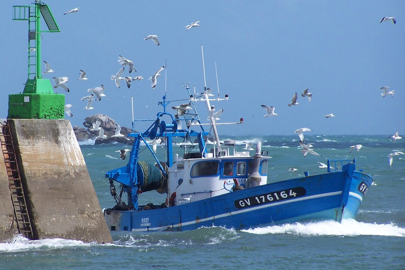 A fishing boat arriving into the port of le Guilvinec.