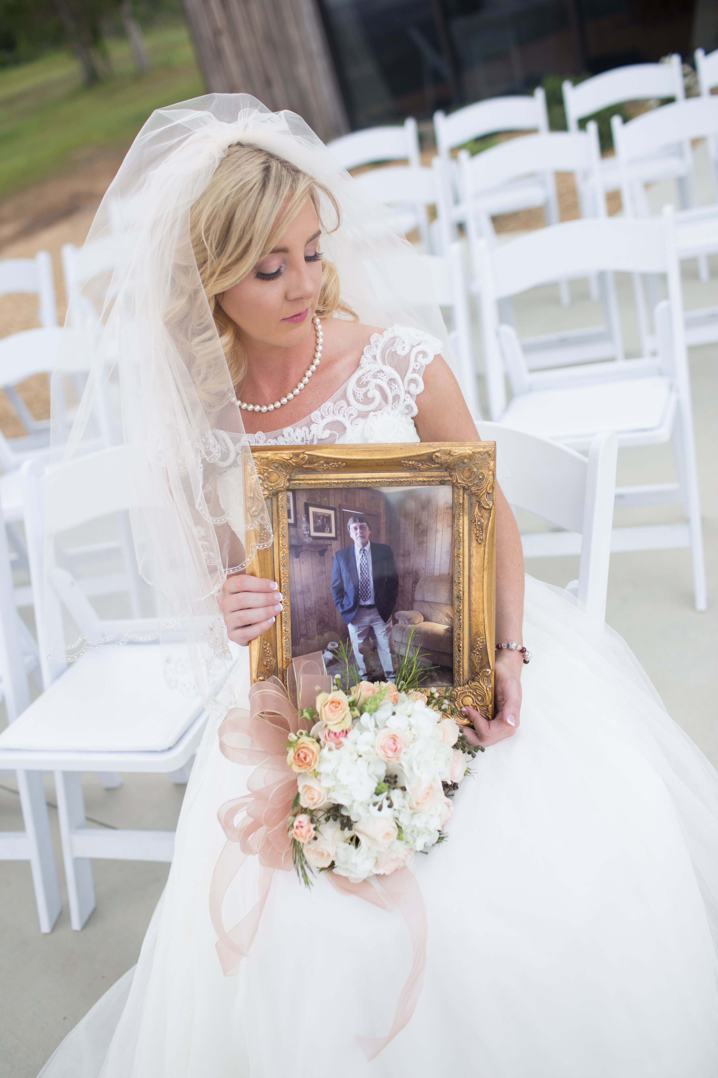 The bride with the picture of her dad.
