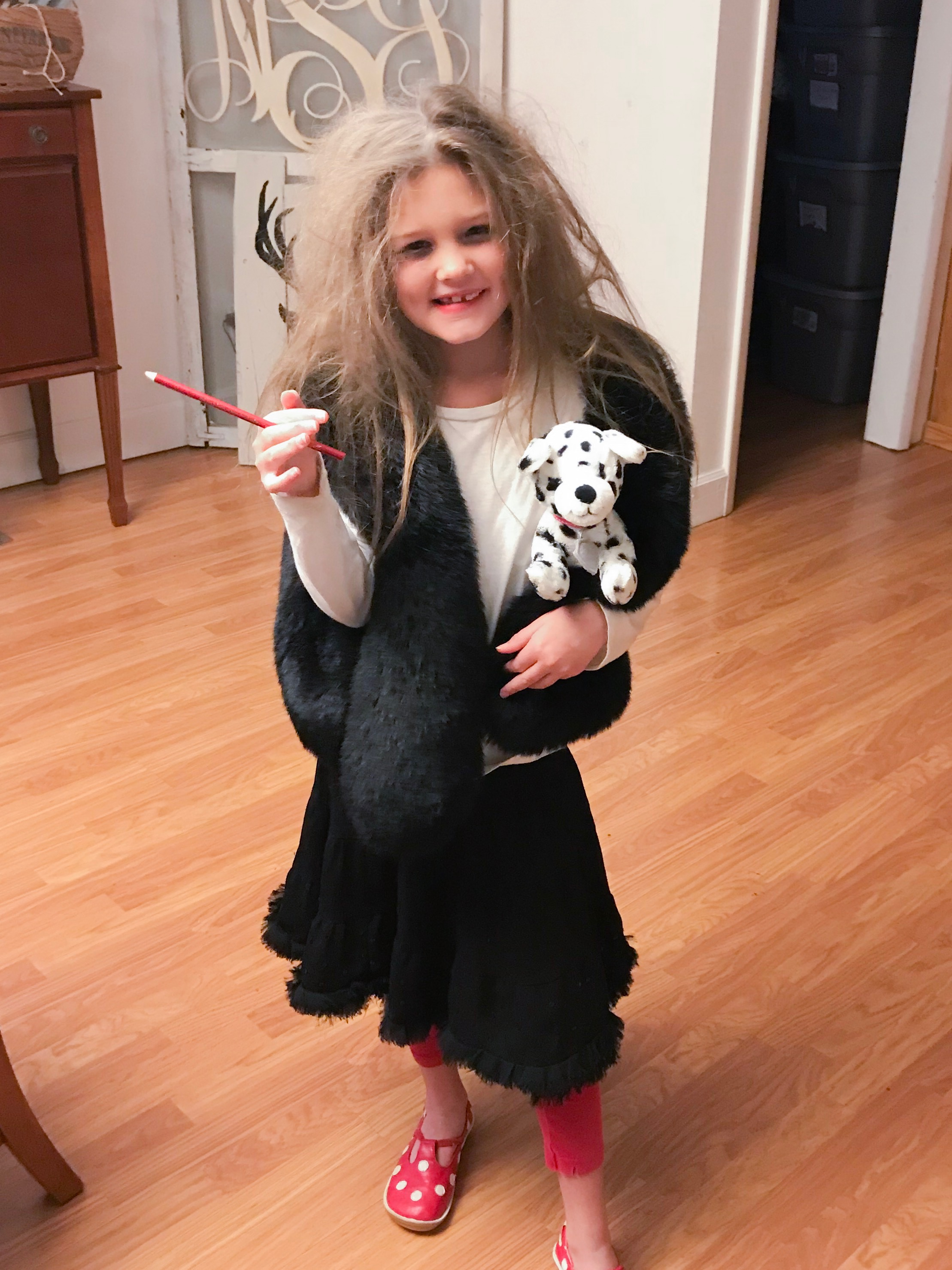 101 Dalmatian theme for their 100th day of school......this is what she looked when she left the house that morning.