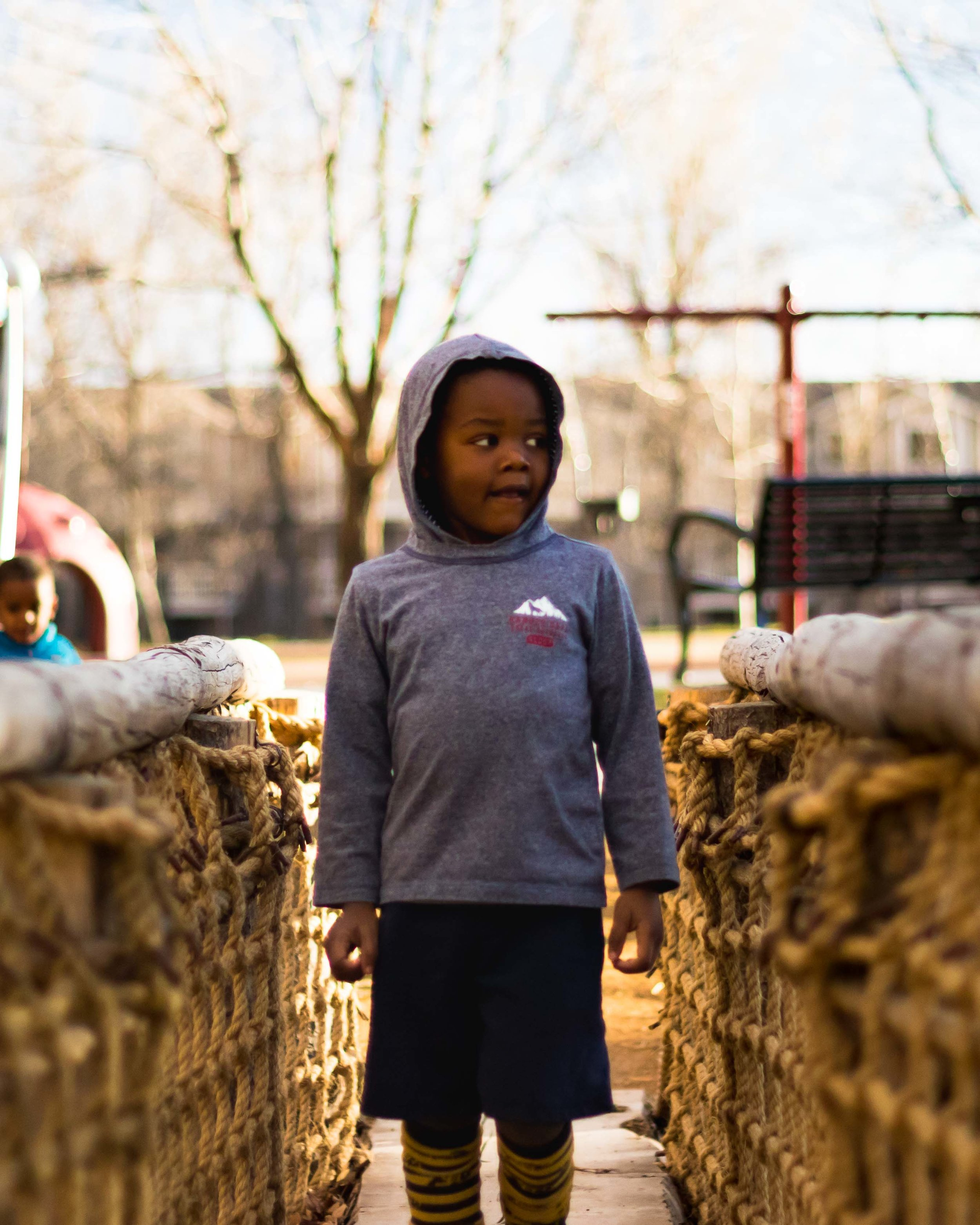 A Boy Stands on a Bridge to Adventure