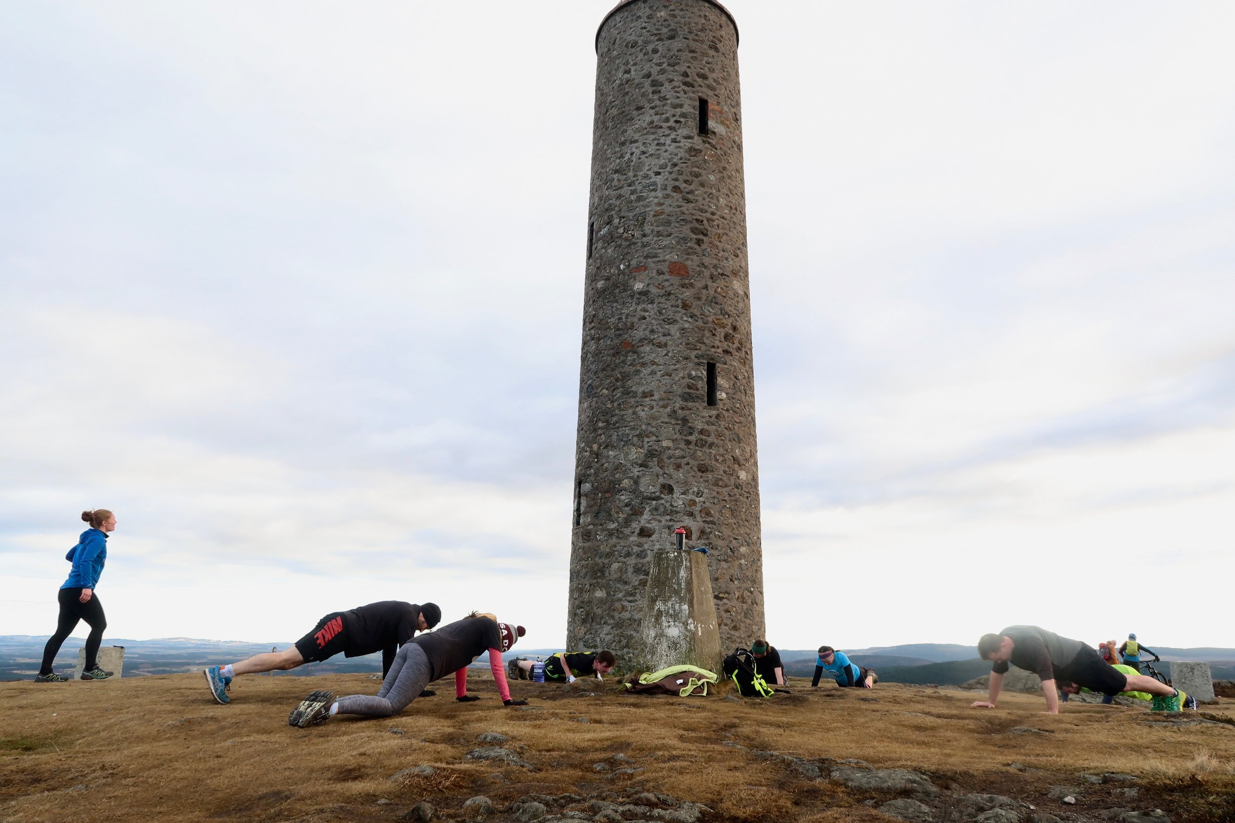 Press ups at the base of the Scolty Tower after a run up the hill!