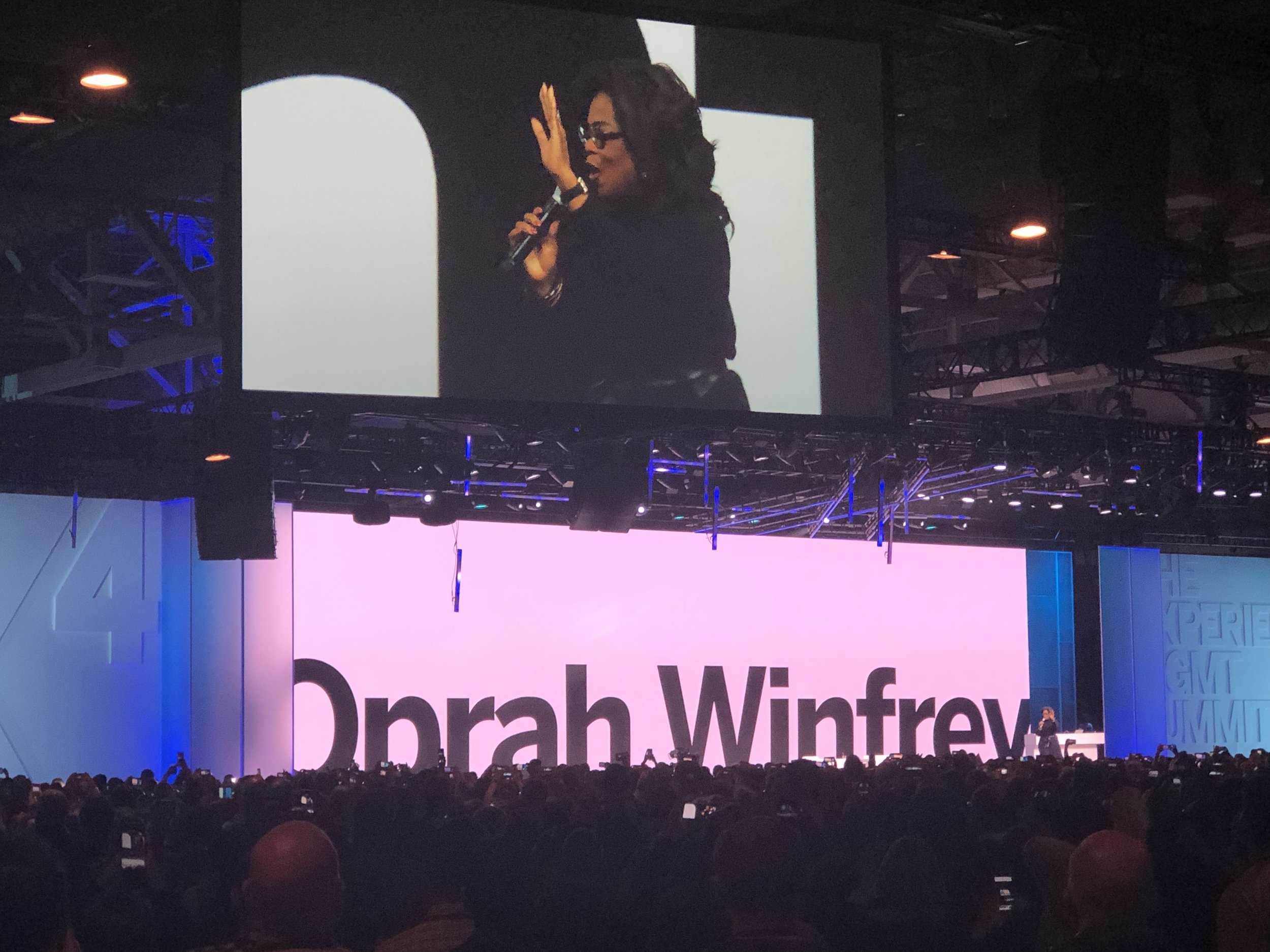 Oprah Winfrey speaking at the conference.