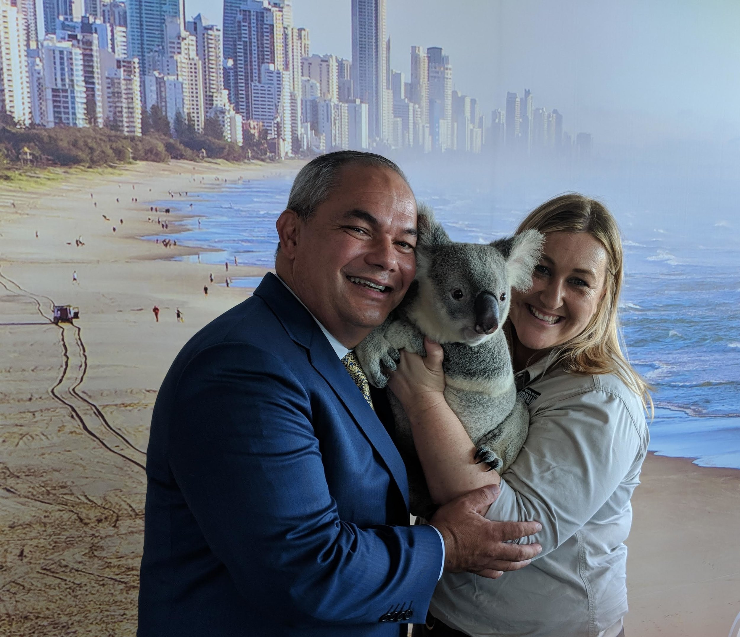 Gold Coast Mayor Tom Tate and a cuddly mate from Currumbin Wildlife Sanctuary.