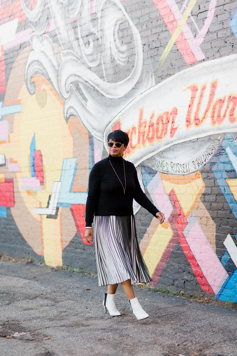 black and white stripe skirt black turtleneck.jpg