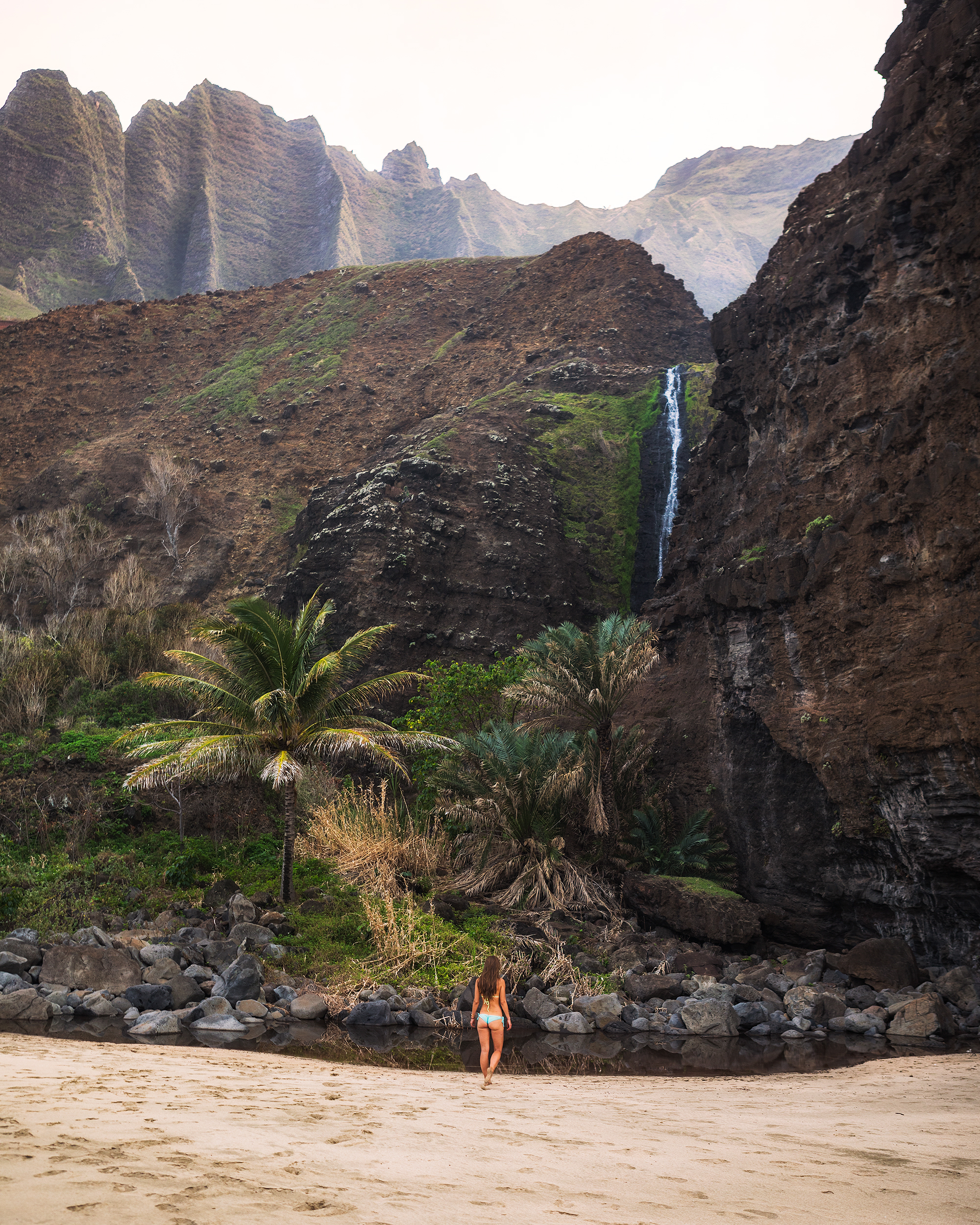 Andrea-at-the-Waterfall-at-Kalalau-Beach-by-Michael-Matti.jpg