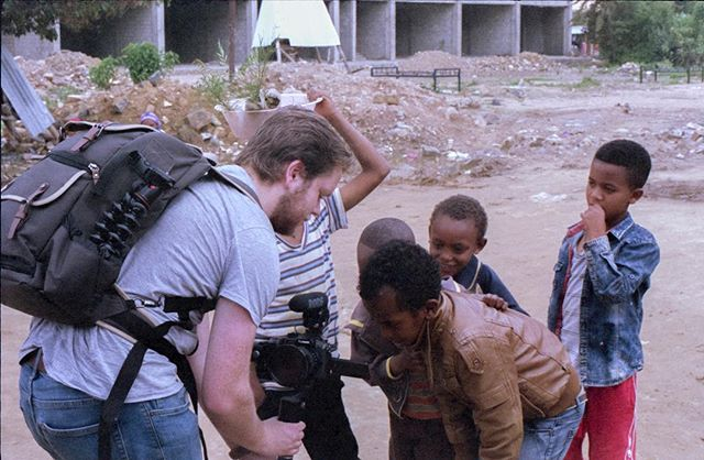 Showing some kids a video I shot in Africa. Also, this photo was shot on some expired Kodak gold 400 with a Pentax k1000. Hand developed and scanned at home. . . . . . #35mm #filmisnotdead #film #analog #analogphotography #ishootfilm #photography #filmcamera #streetphotography #filmcommunity #35mmfilm #analogue #buyfilmnotmegapixels #believeinfilm #analoguevibes #kodak #filmfeed #staybrokeshootfilm #filmisalive #leica #fujifilm #filmphoto #photooftheday #keepfilmalive #theanalogclub #art #photo #travel #filmmaking #thefilmcommunity