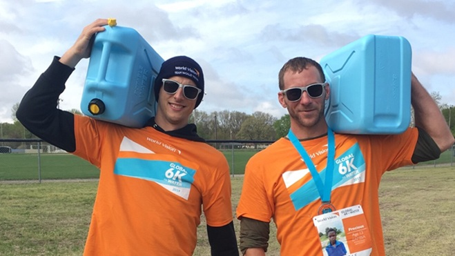 Pictured Above: Kevin Nelms and Brandon DeYoung carrying the Jerry cans to demonstrate how far the average person in a developing country has to carry water. Water that is often dirty and disease ridden.