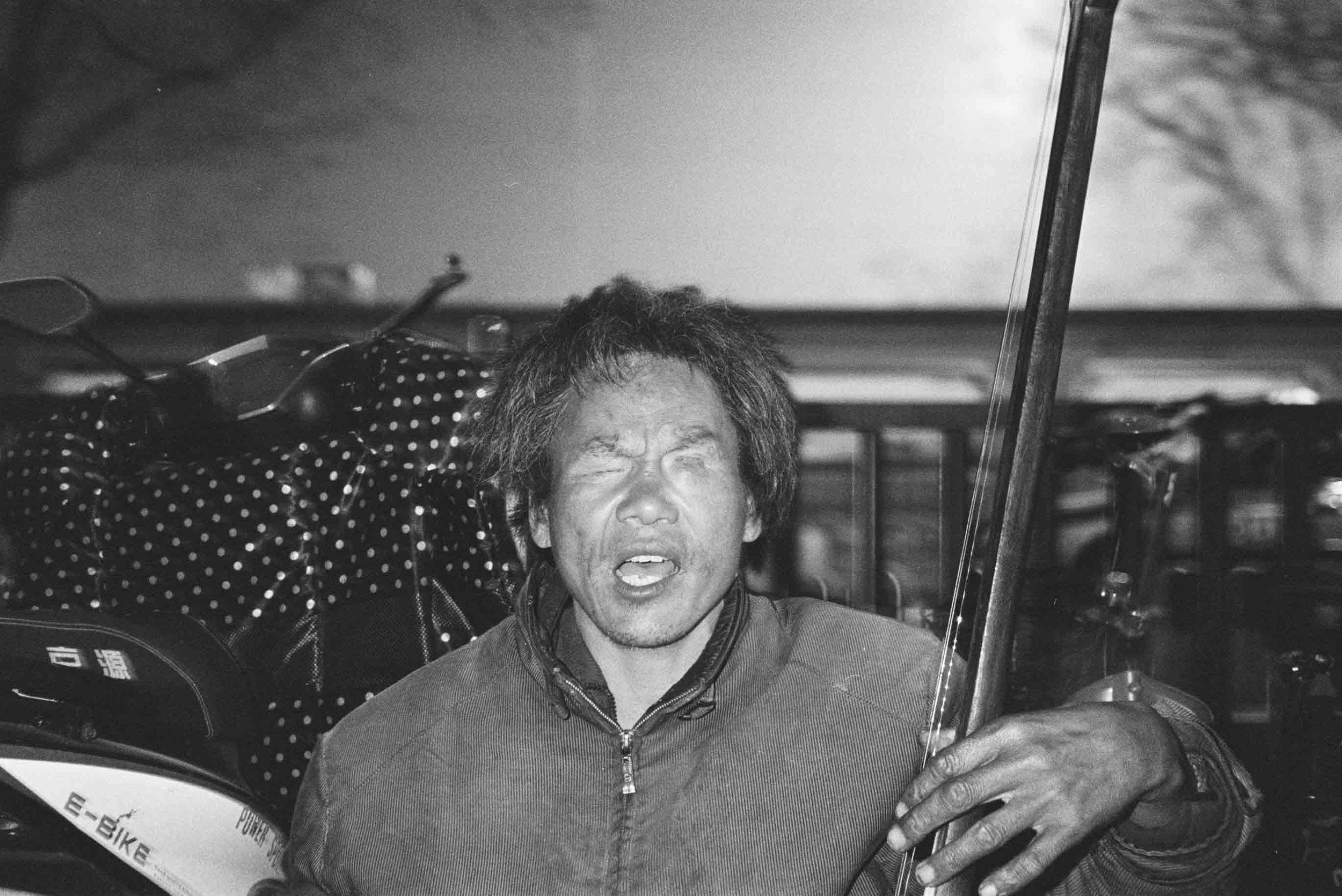 Blind Street Performer. Beijing, 2018.