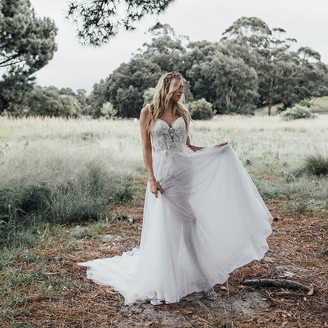 Our Ivy gown featuring a sheer sparkle skirt and floral embellishments,  Want to try her on? Enquire  at www.ivonncouture.com  Photographer @sonja.cenic.photographer