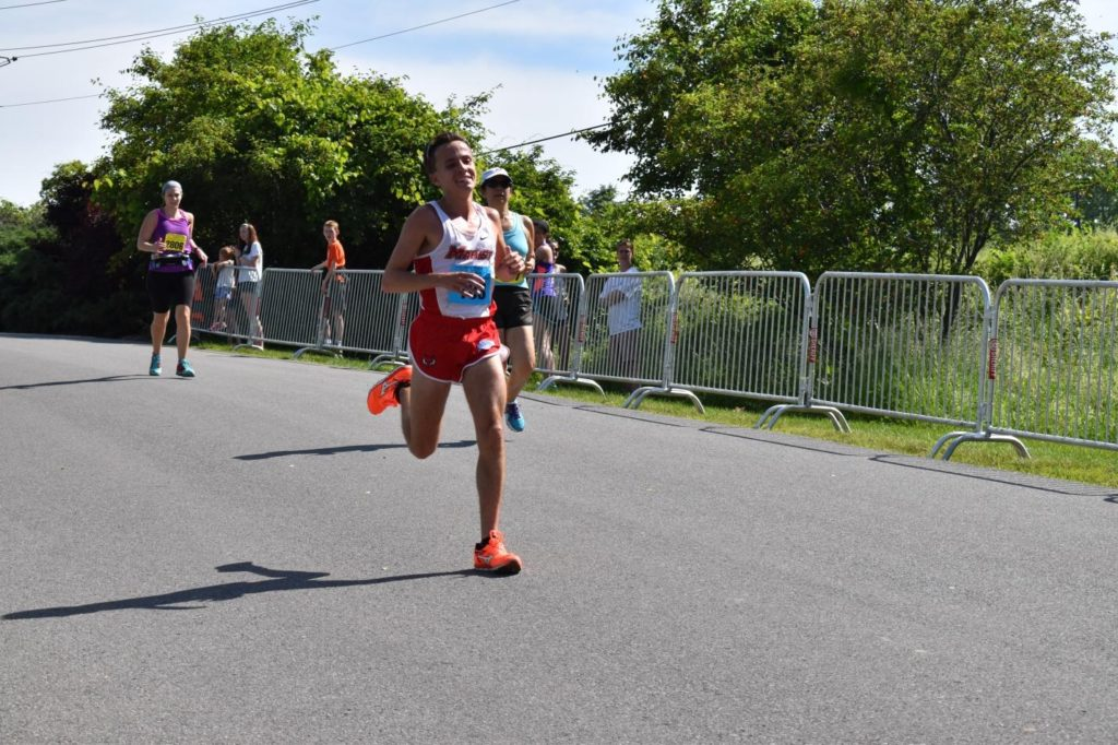 Spencer Johnson, finishing first in the Walkway Marathon in a time of 2:39:32, completing his first ever marathon.