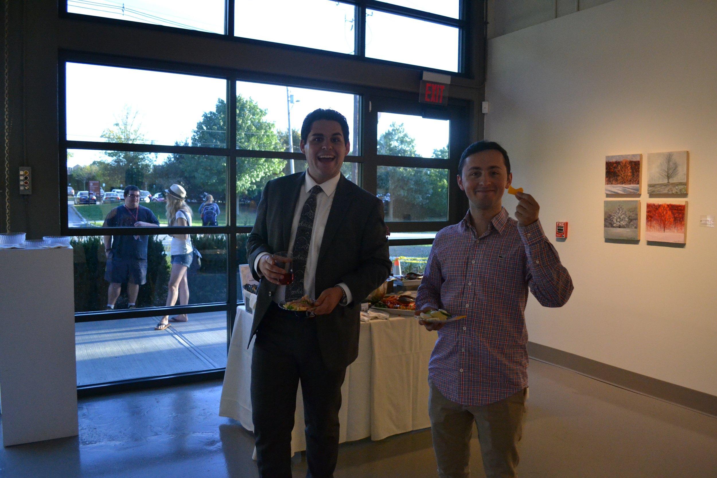Seniors Salvatore Isola (Left) and Joseph Kopp (Right) enjoying the gallery and some refreshments.