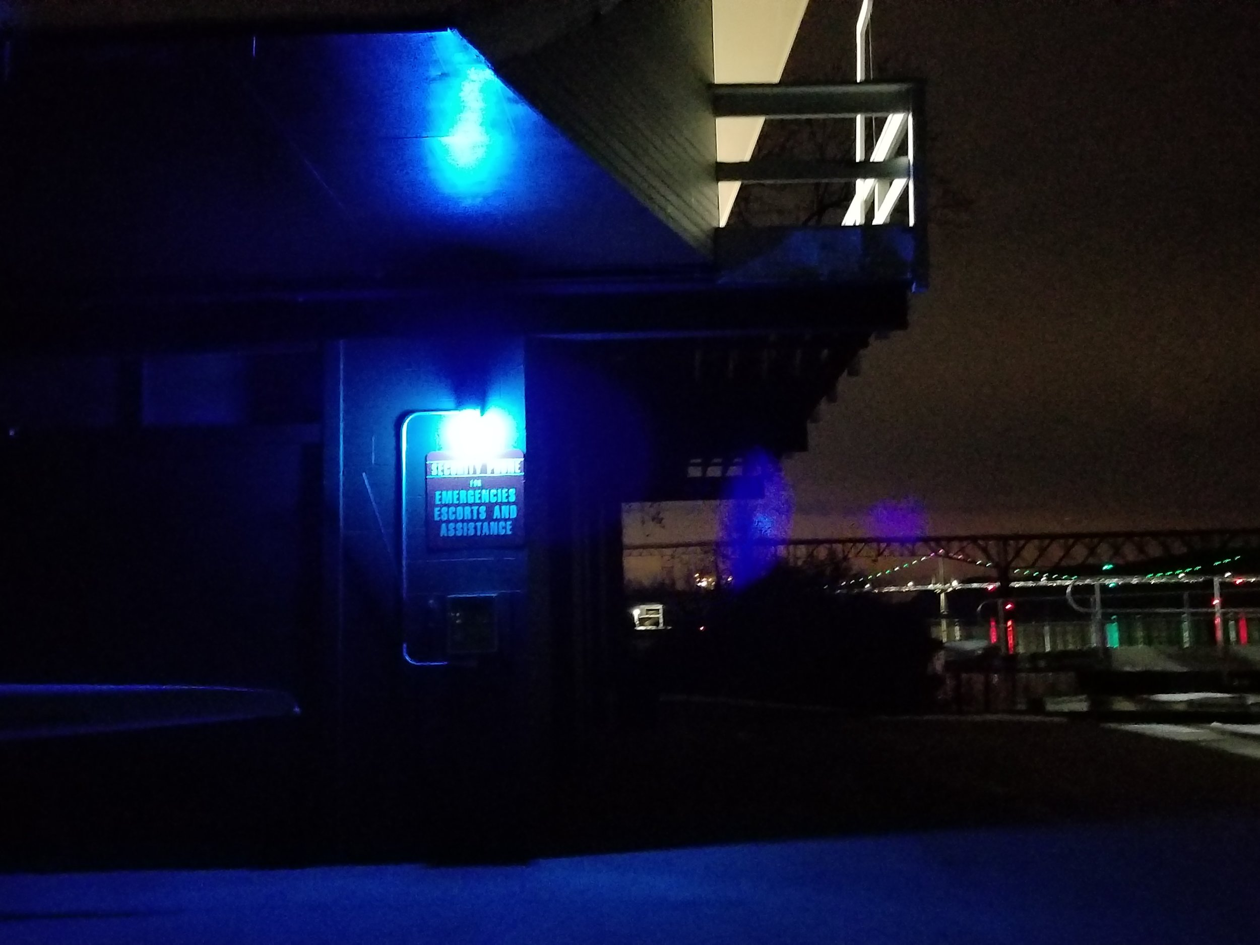 The callbox is not visible in its own blue-light and darkness.