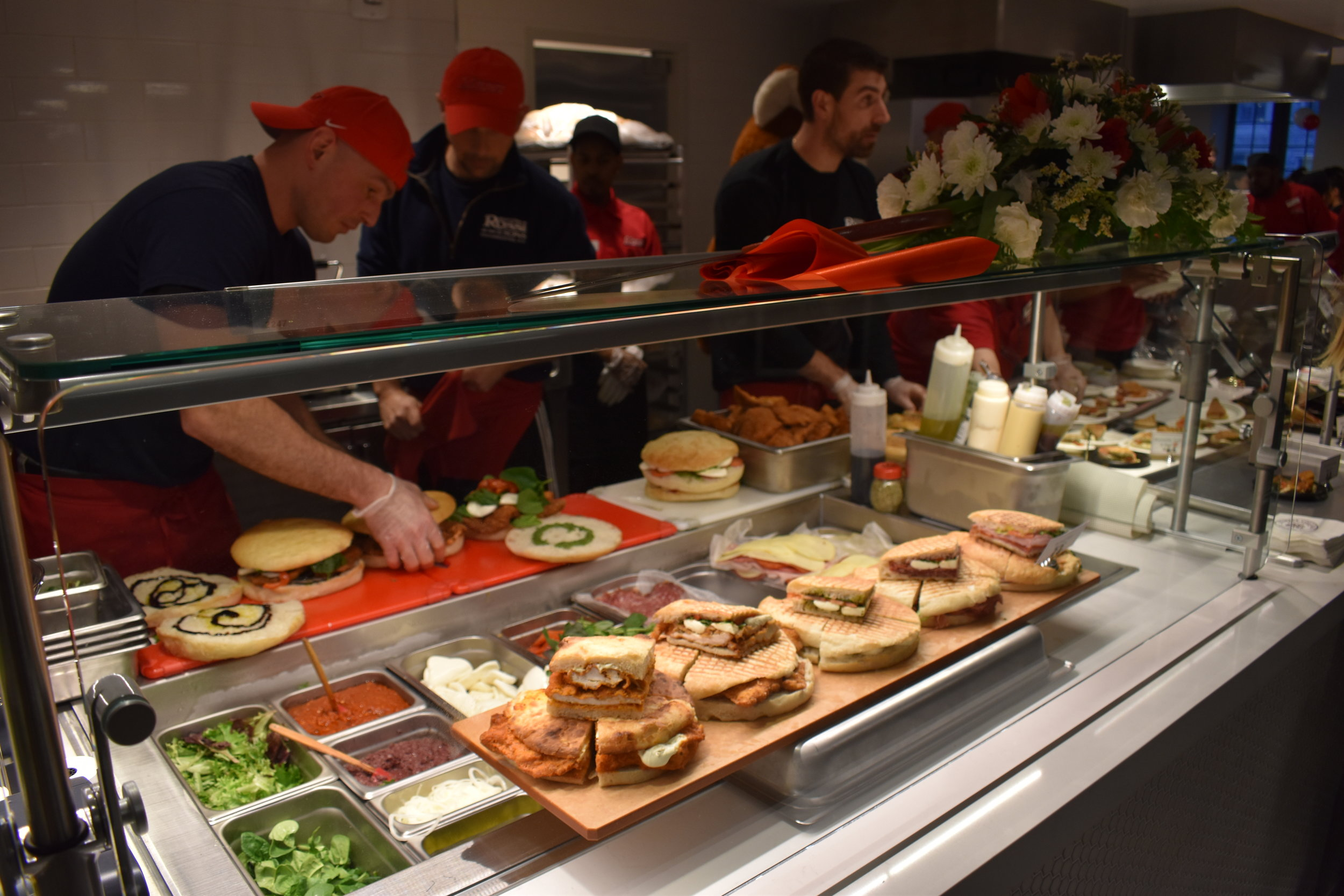 Rossi and Sodexo staff preparing sandwich samples for Marist students.