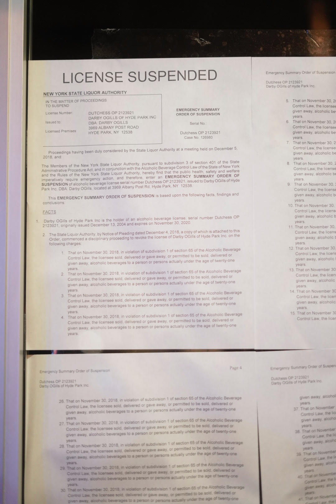 Suspension notices posted on door of Darby O Gill's Wednesday evening. Photo by Ken Haung '20.