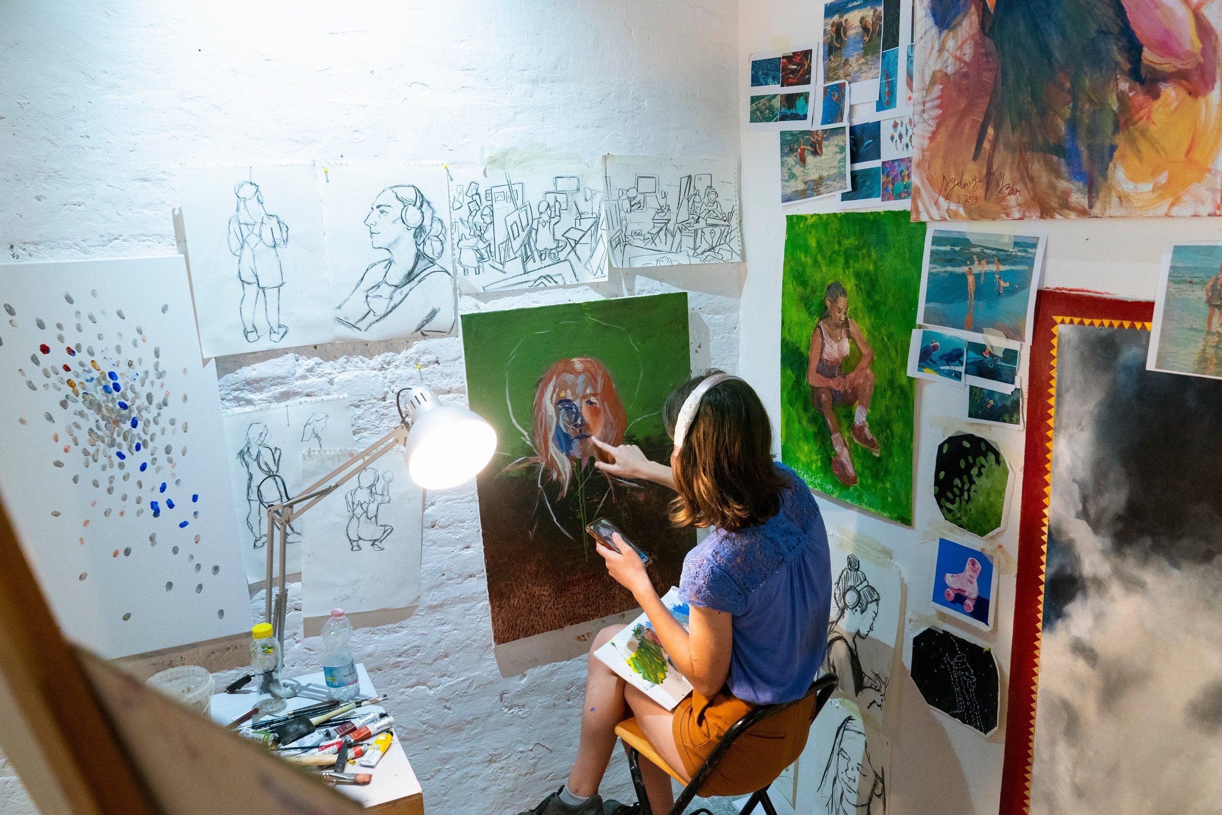 Kysar painting in her studio space