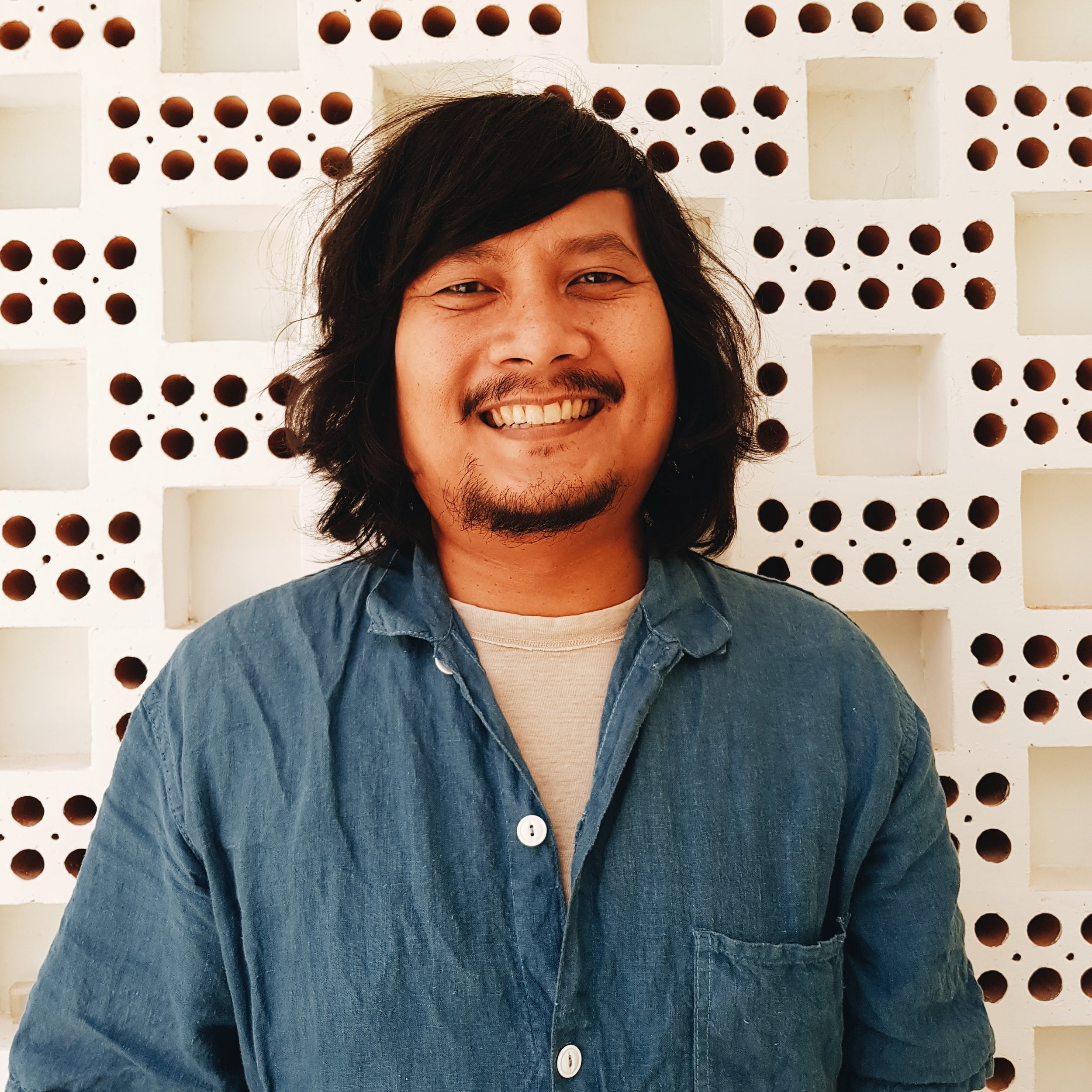 "Mikael Johani  is a poet, critic, and translator from Jakarta, Indonesia. His works have been published in  Asymptote, The Johannesburg Review of Books, Ajar (Hanoi), Vice Indonesia, Kerja Tangan (Kuala Lumpur), Murmur, Selatan, Popteori, Vita Traductiva (Montréal), What's Poetry?, Bung! , and others. His poetry book, ""We Are Nowhere And It's Wow"", was published by Post Press in 2017. He's working on ""mongrelz"", his second poetry collection, which will feature mostly codeswitching poems. He's also working on a translation of Gratiagusti Chananya Rompas's poetry collection, ""Non-Spesifik."" His English version of ""one by one the bodies died"", a poem from Non-Spesifik, won an Honourable Mention from the 2018 Hawker Prize for Southeast Asian Poetry. He is one of the winners of the 2018-19 Emerging Translator Mentorships Programme from the UK's National Centre for Writing. He organizes Paviliun Puisi, a monthly open mic gig in Jakarta."