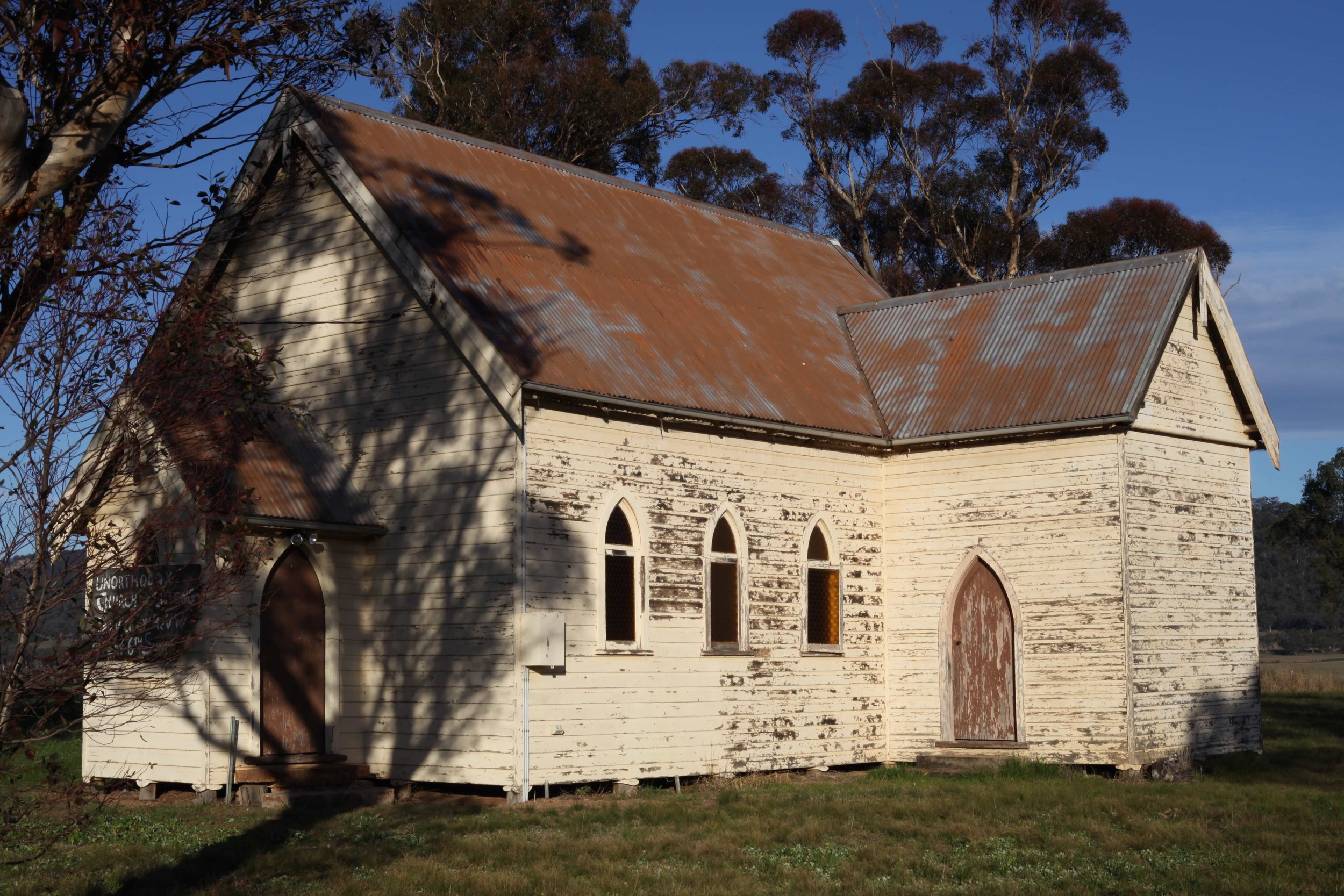 Bylong's now closed Catholic Church. The church is now owned by KEPCO, the company seeking to develop a coal mine in the Bylong valley. There is a small cemetery behind the church and KEPCO plan to have the graves  dug up and moved  to make way for the proposed mine.