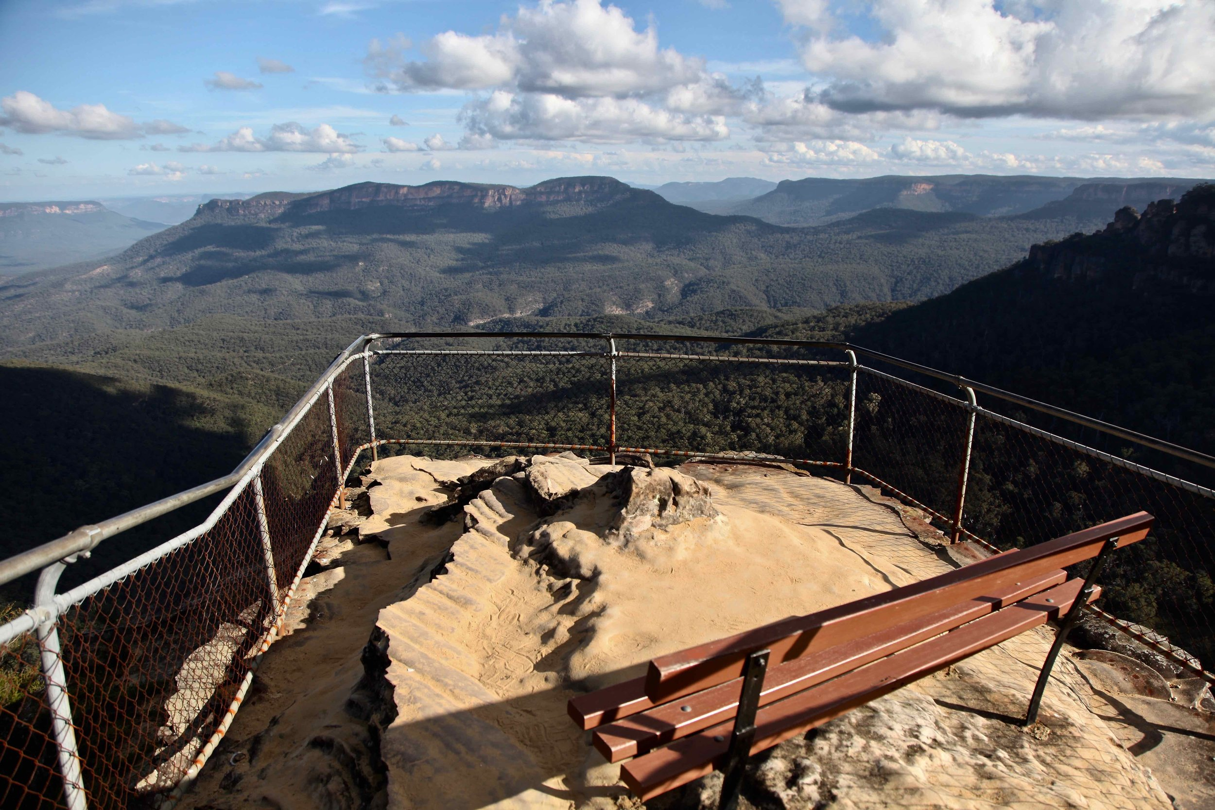 Pack a picnic and pull up a pew and enjoy this view of the Blue Mountains near Leura.