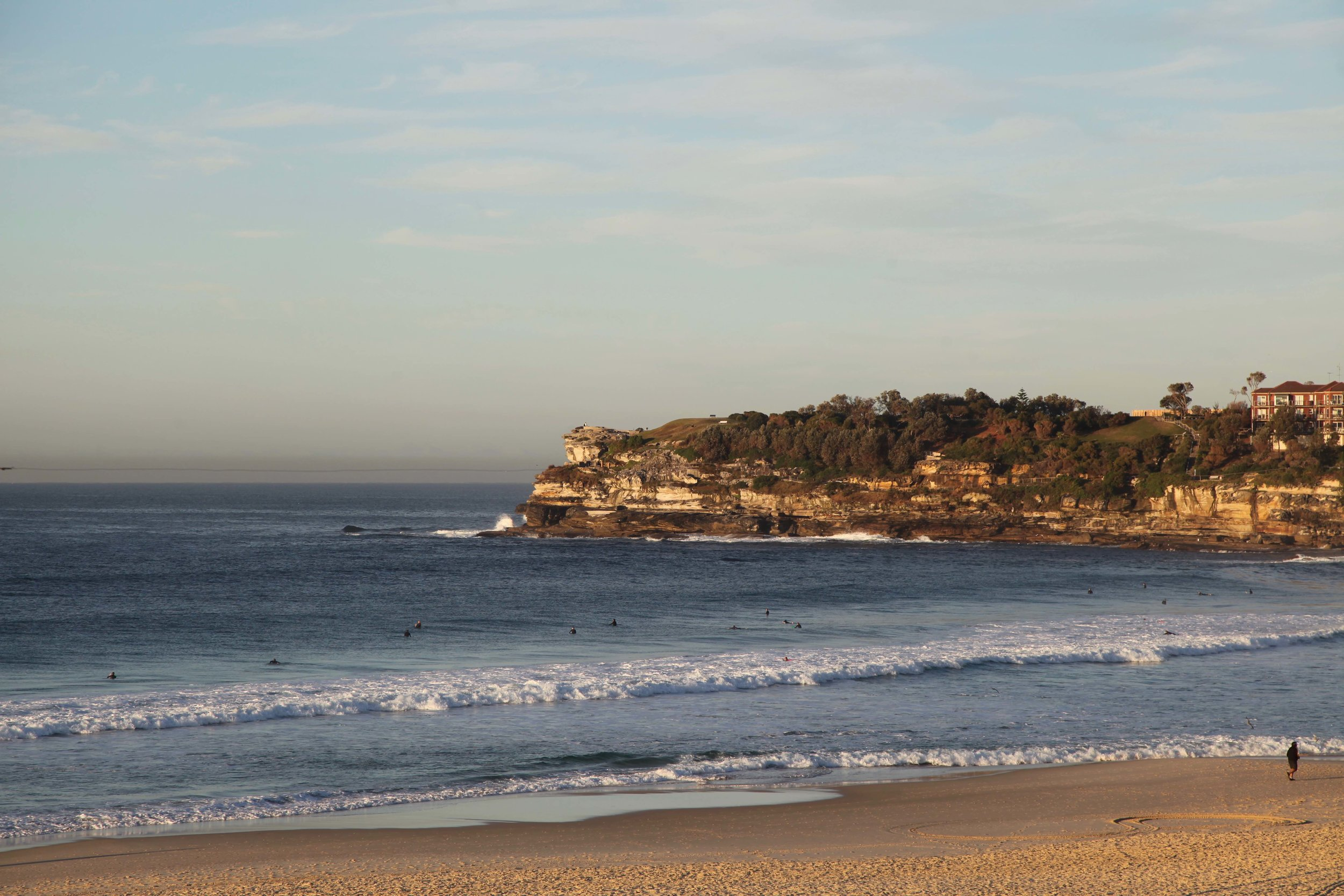 Surfers waiting for waves at Bondi Beach in the morning.