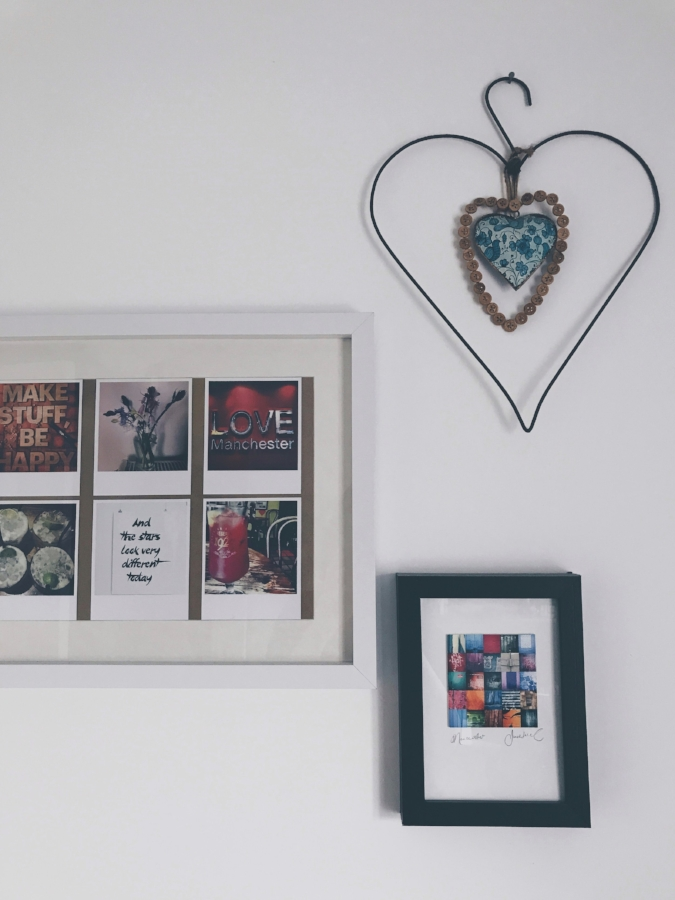 A collection of my own polaroids and a Jack Lloyd print give a really simple update to a plain white wall in my dressing room.