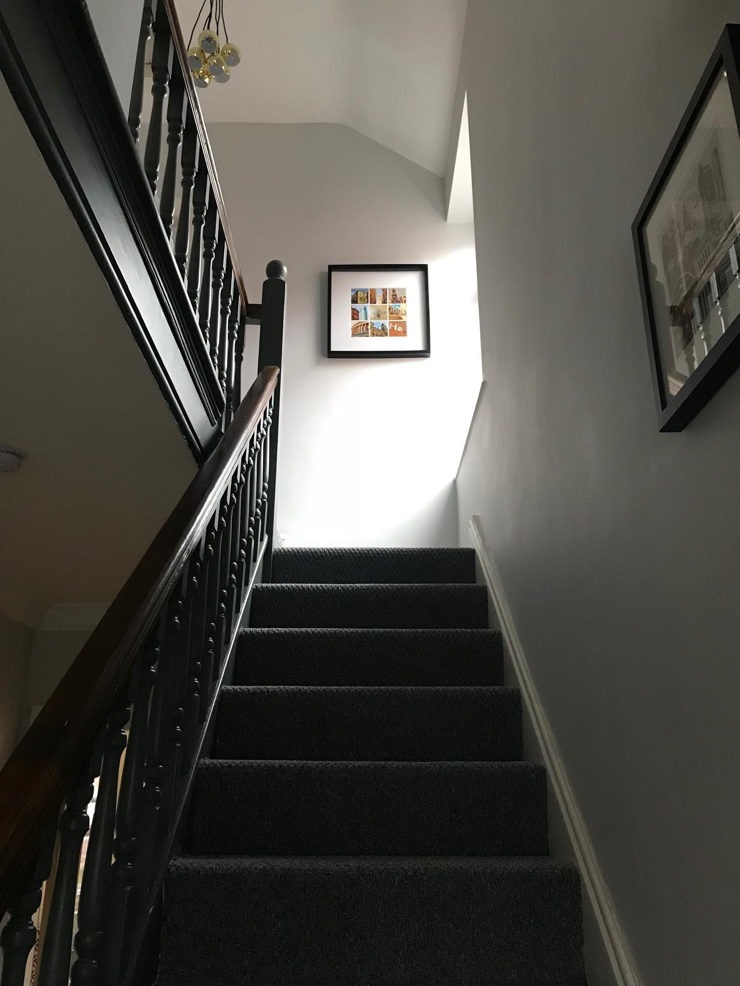 View up the stairs onto the landing.
