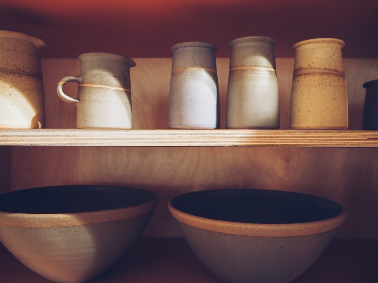 Tony Gant Pottery displayed in Pluck Kitchen cabinet at Clerkenwell Design Week.