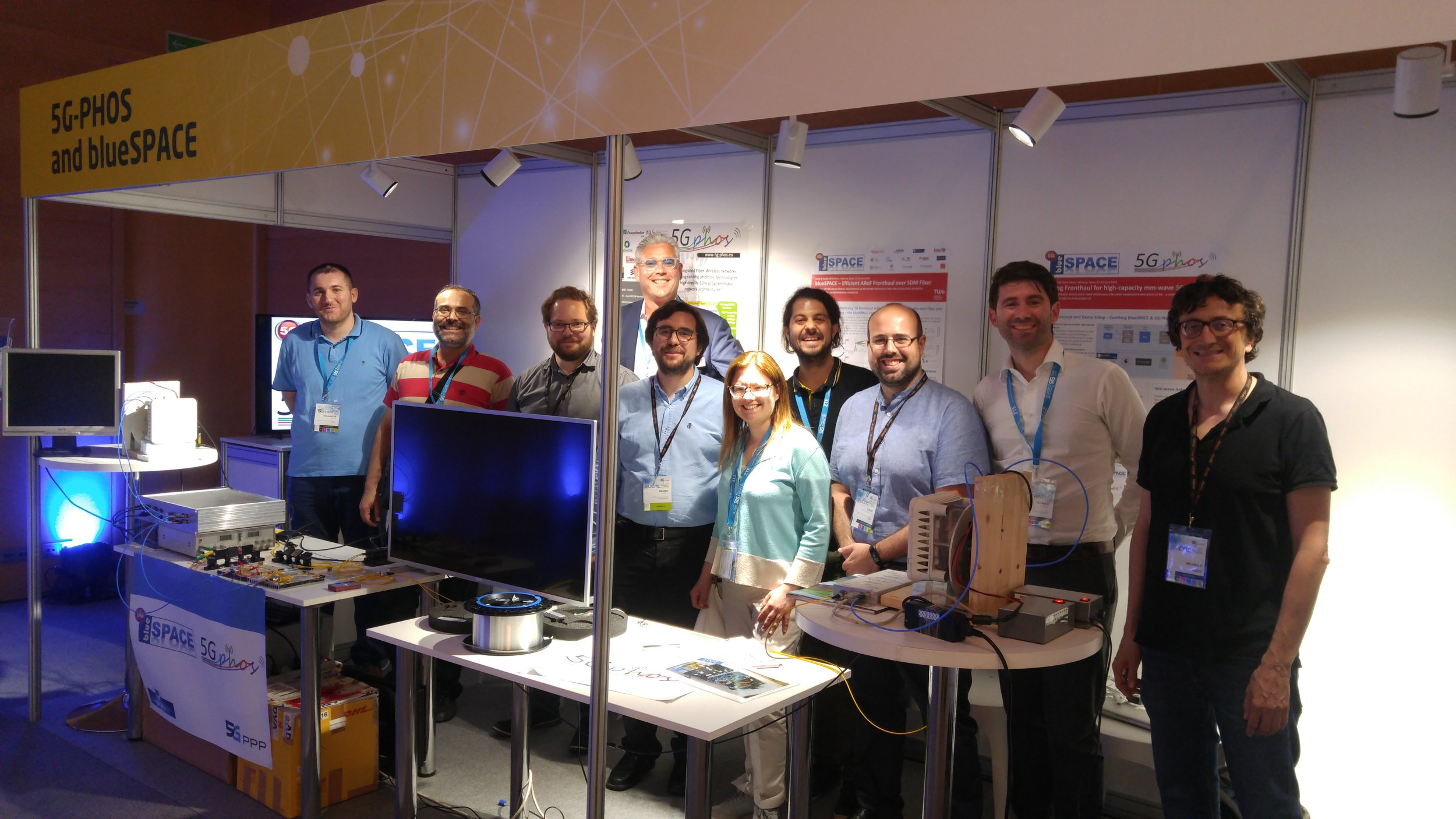 Demo booth with visiting consortium members from both projects.