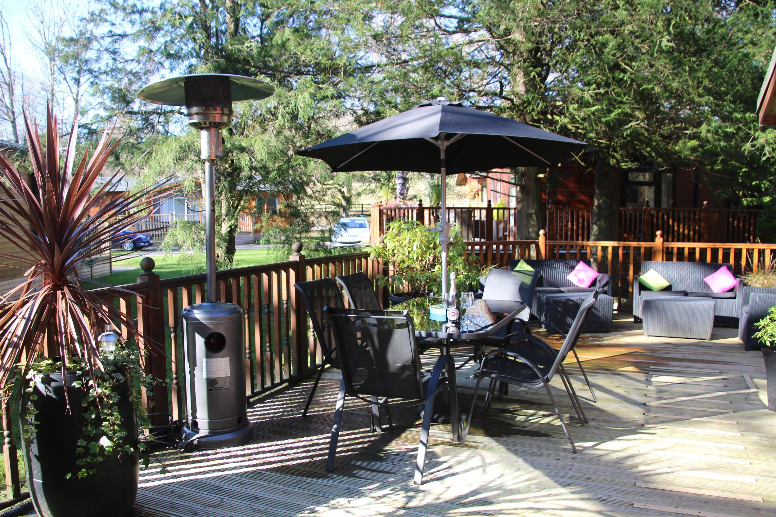 Large outdoor deck with dining furniture and sofas