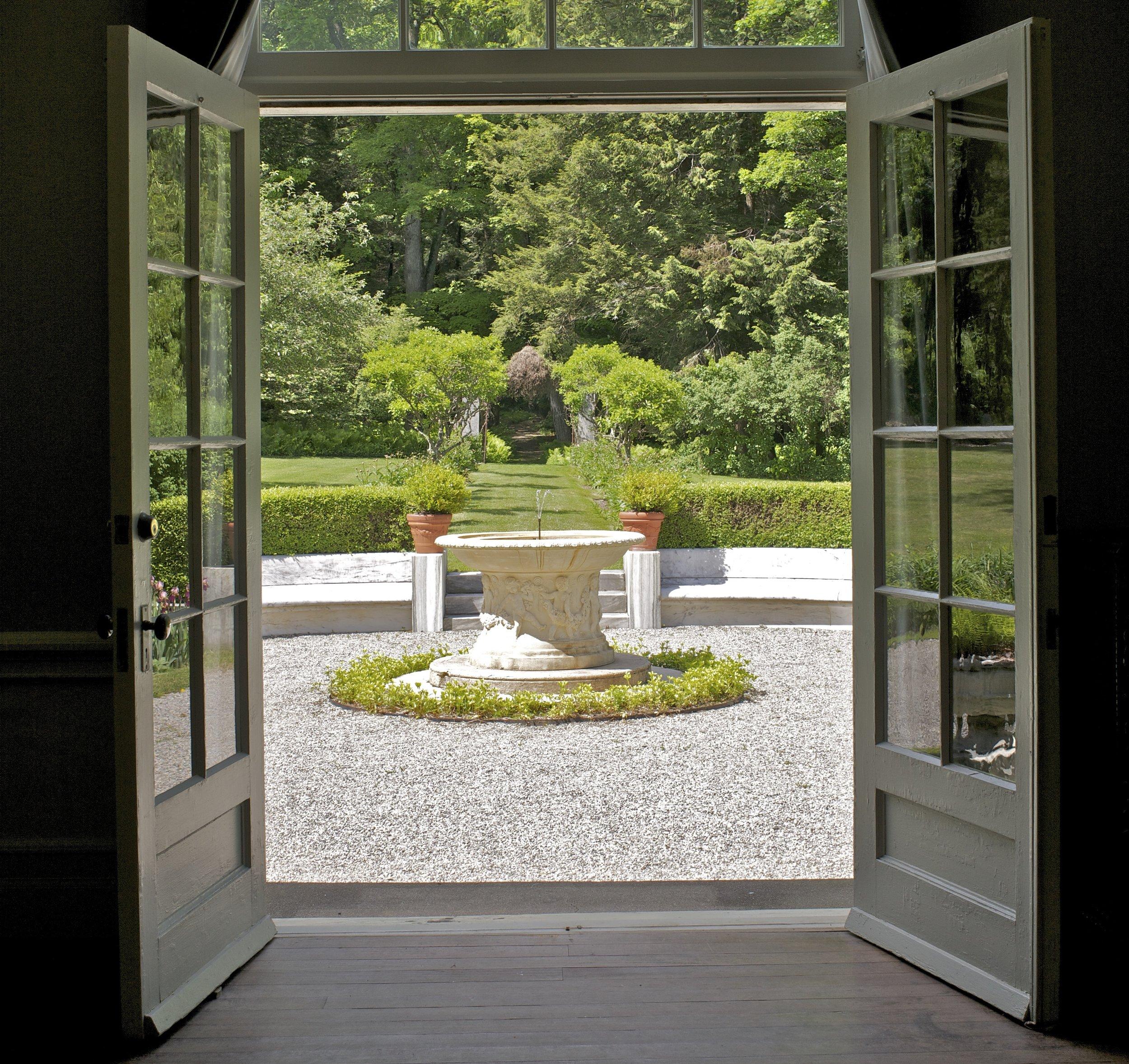 Garden and fountain through studio north doors cropped.jpg