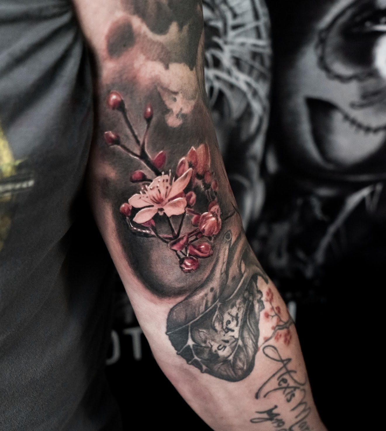 Photorealistic flower tattoo by Scoot Ink