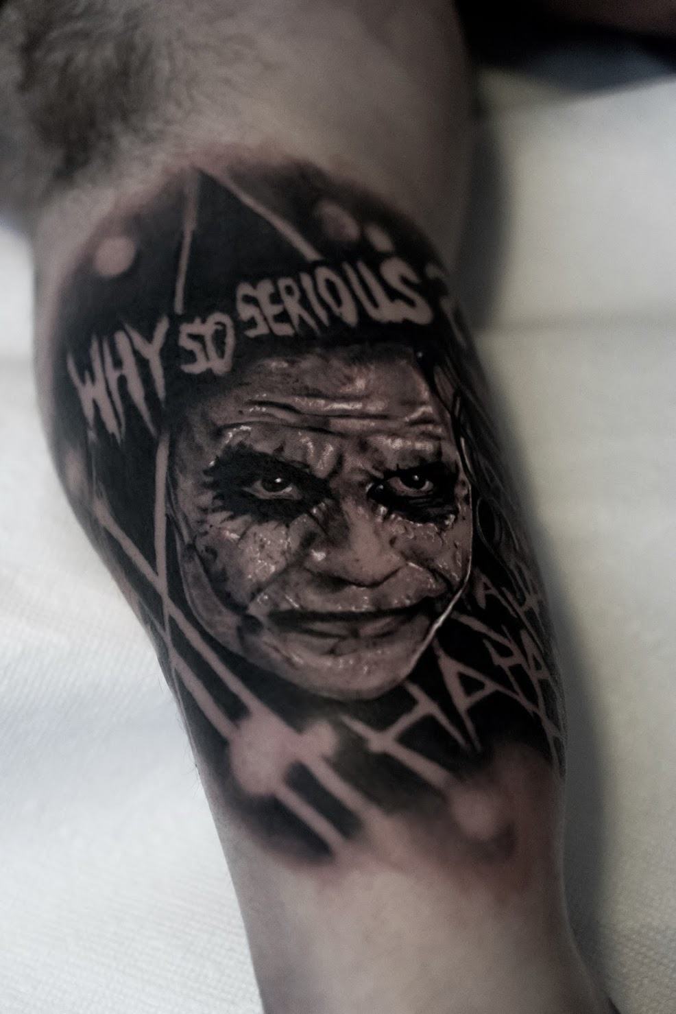 Photorealistic joker tattoo by Scoot Ink