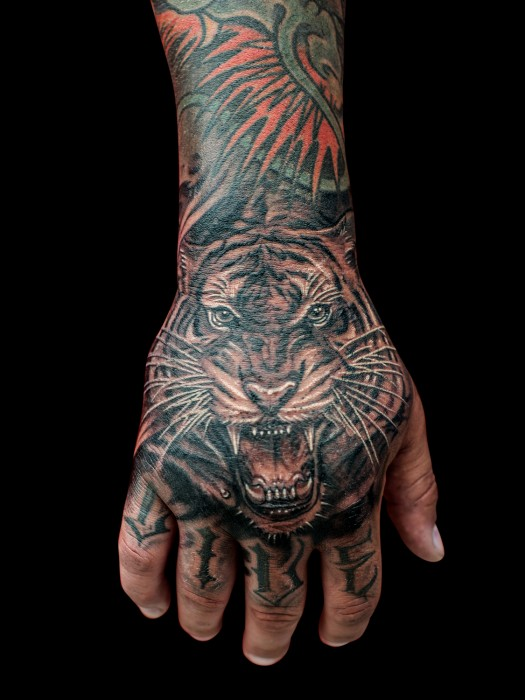 Photorealistic tiger tattoo by Winson Tsai