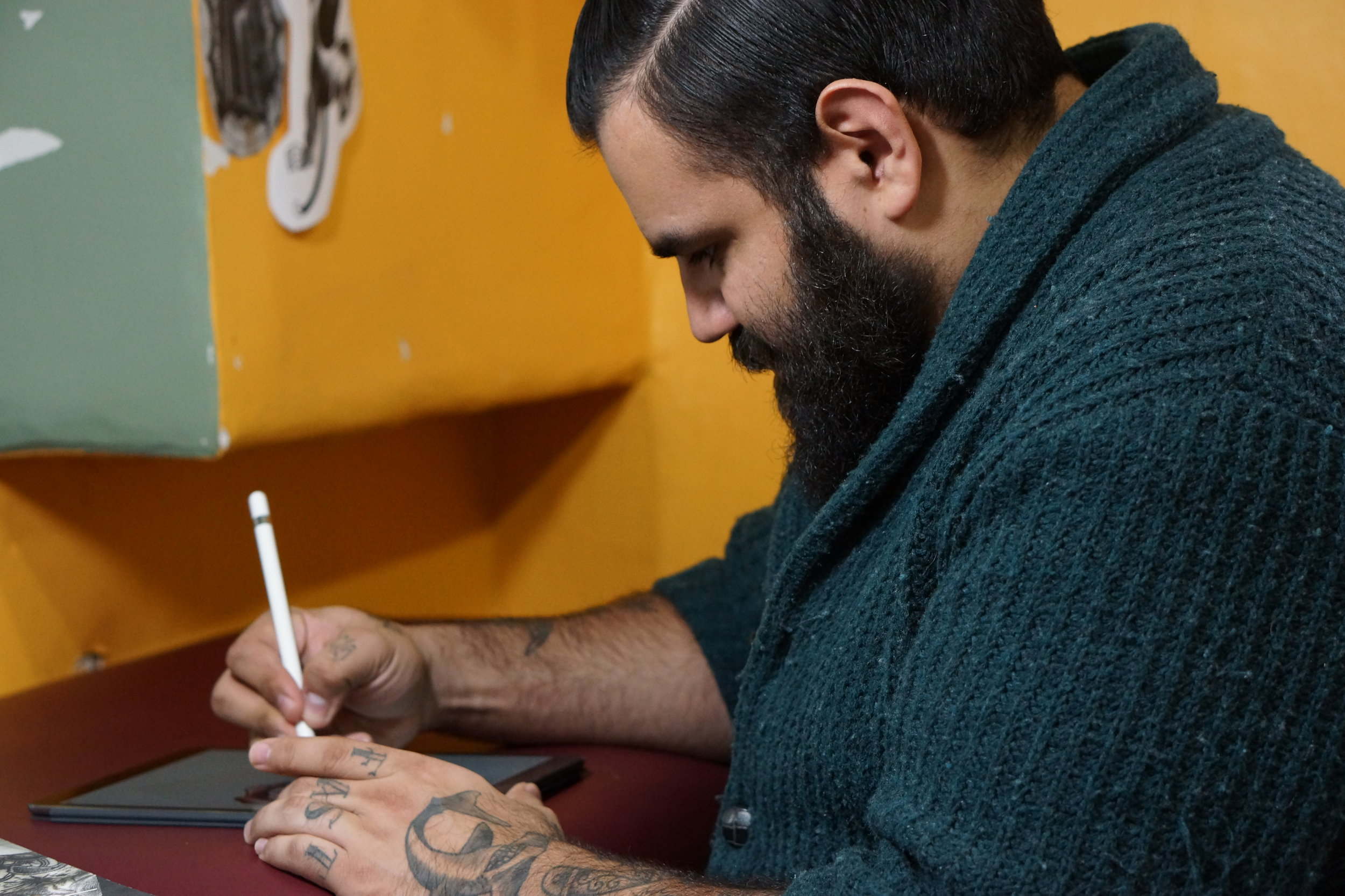 German is a traditional tattoo artist in Toronto