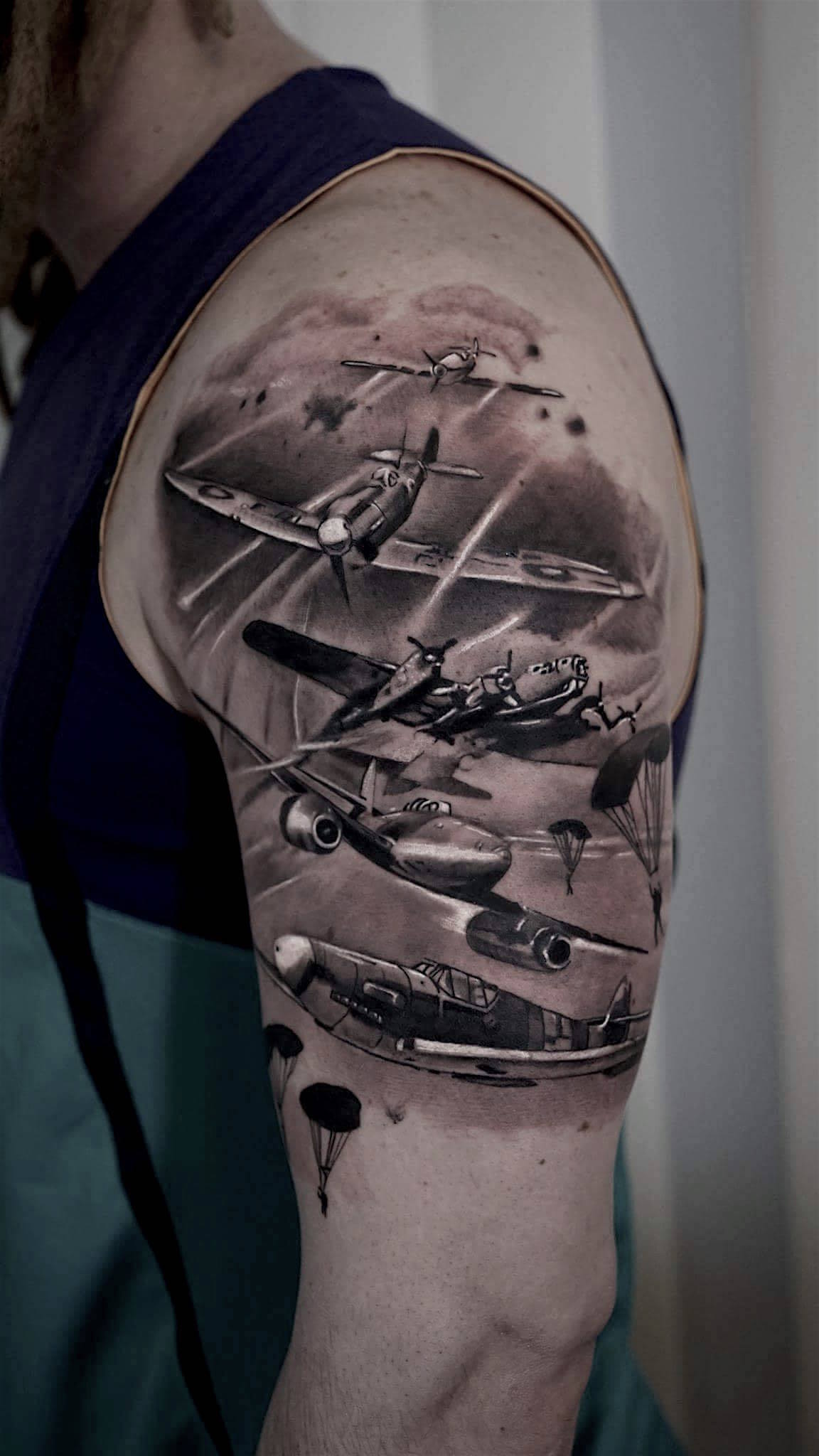Photorealistic dog-fight tattoo by  Scoot Ink