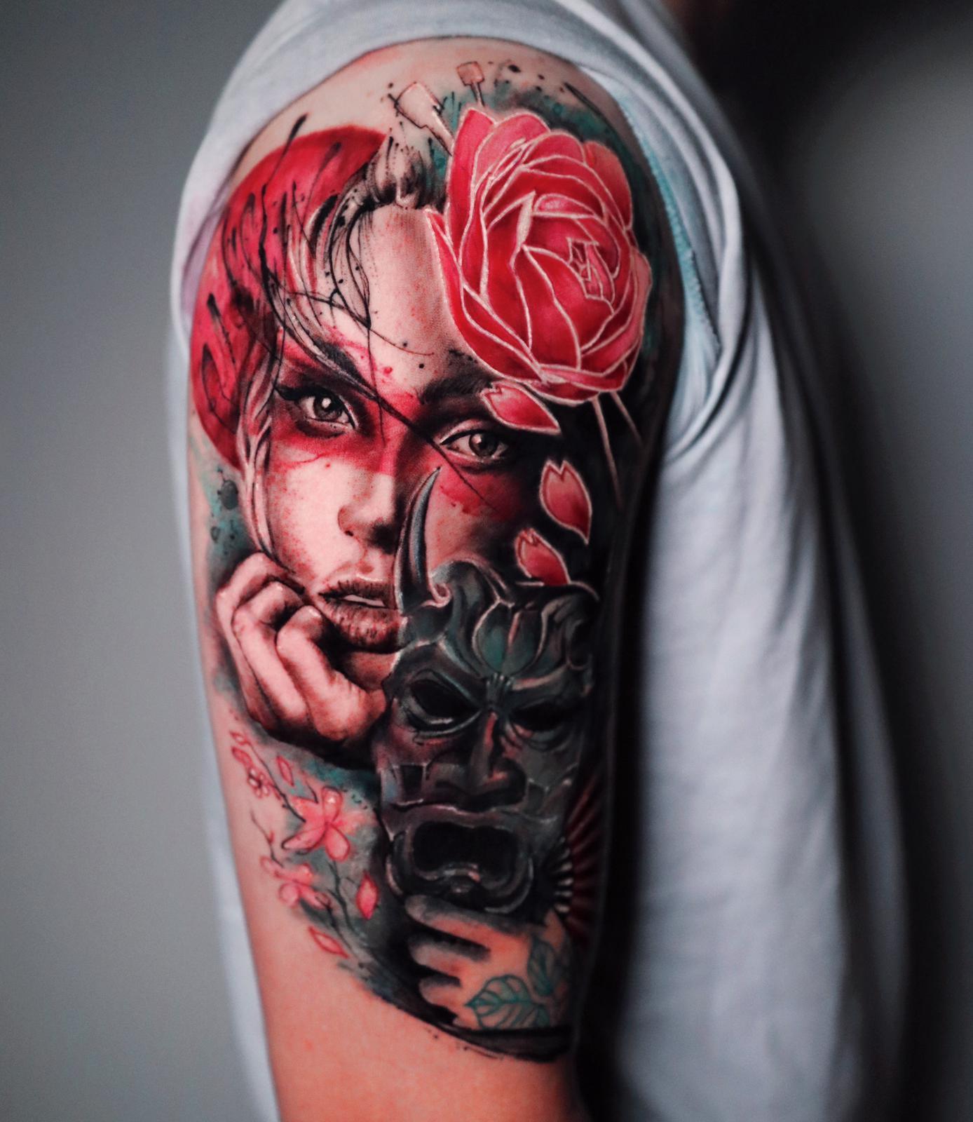 Watercolour photorealistic tattoo by Nico