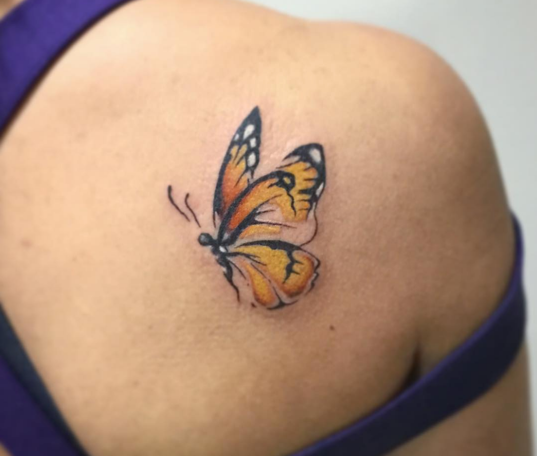 Watercolour butterfly tattoo by CT