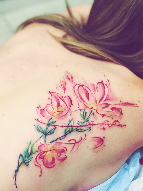 Watercolour flower tattoo by Nico