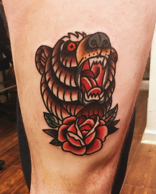 Traditional bear tattoo by German