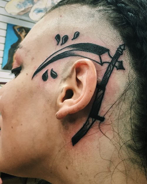 Traditional scythe tattoo by German