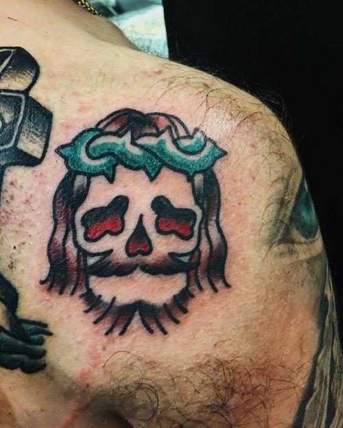 Traditional Jesus skull tattoo by German