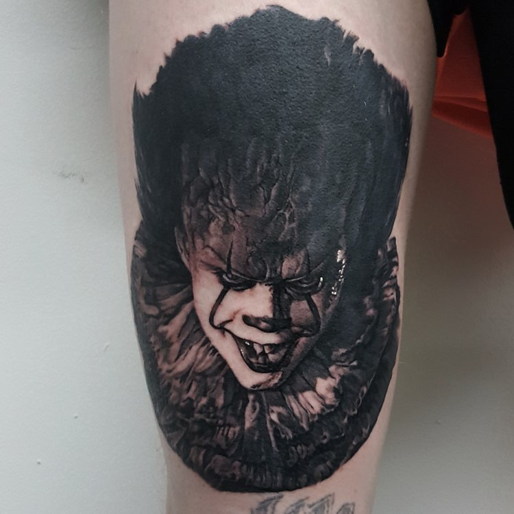 Photorealistic pennywise the clown tattoo