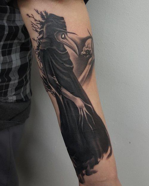 Realistic reaper tattoo