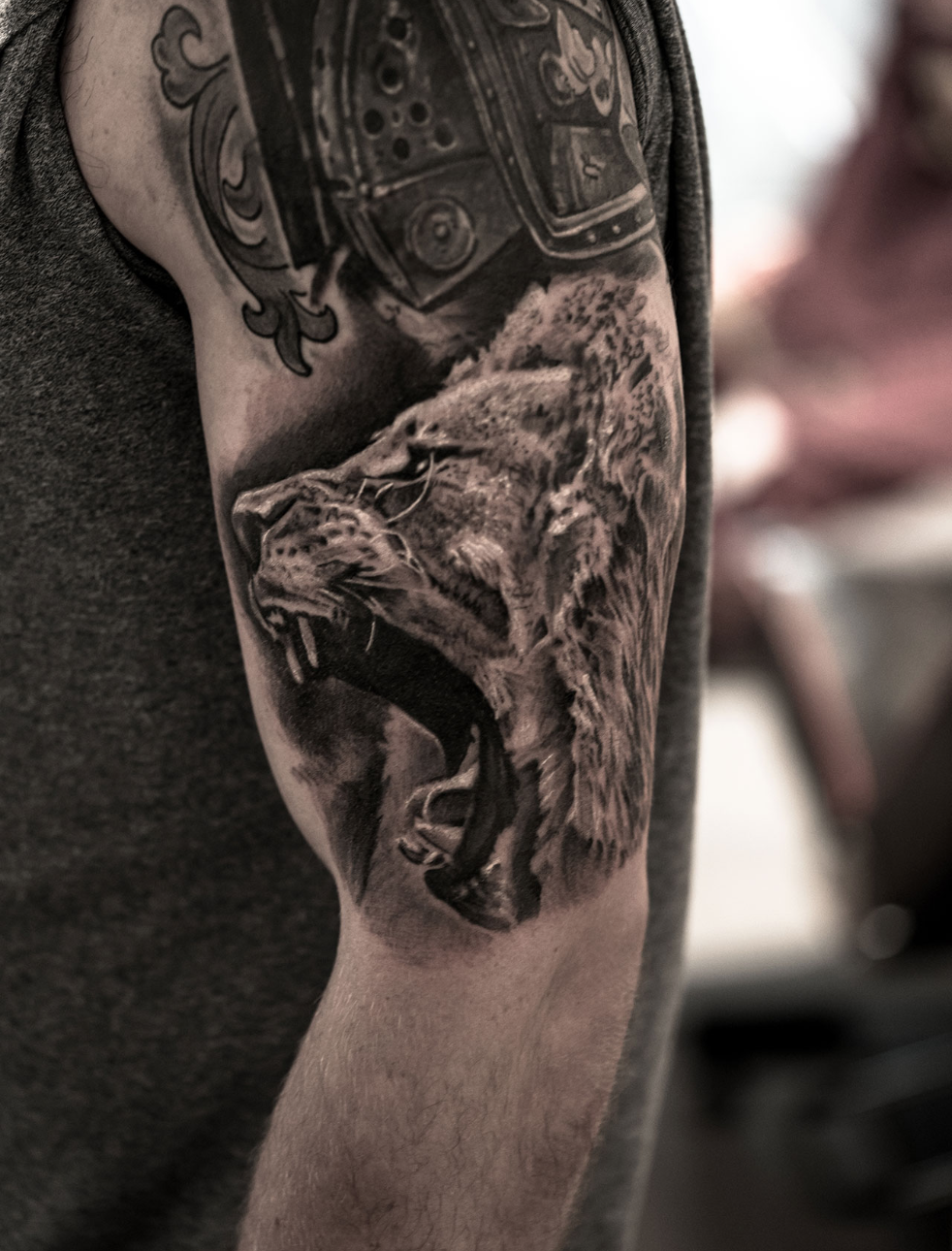 Photorealistic lion tattoo by Scoot Ink