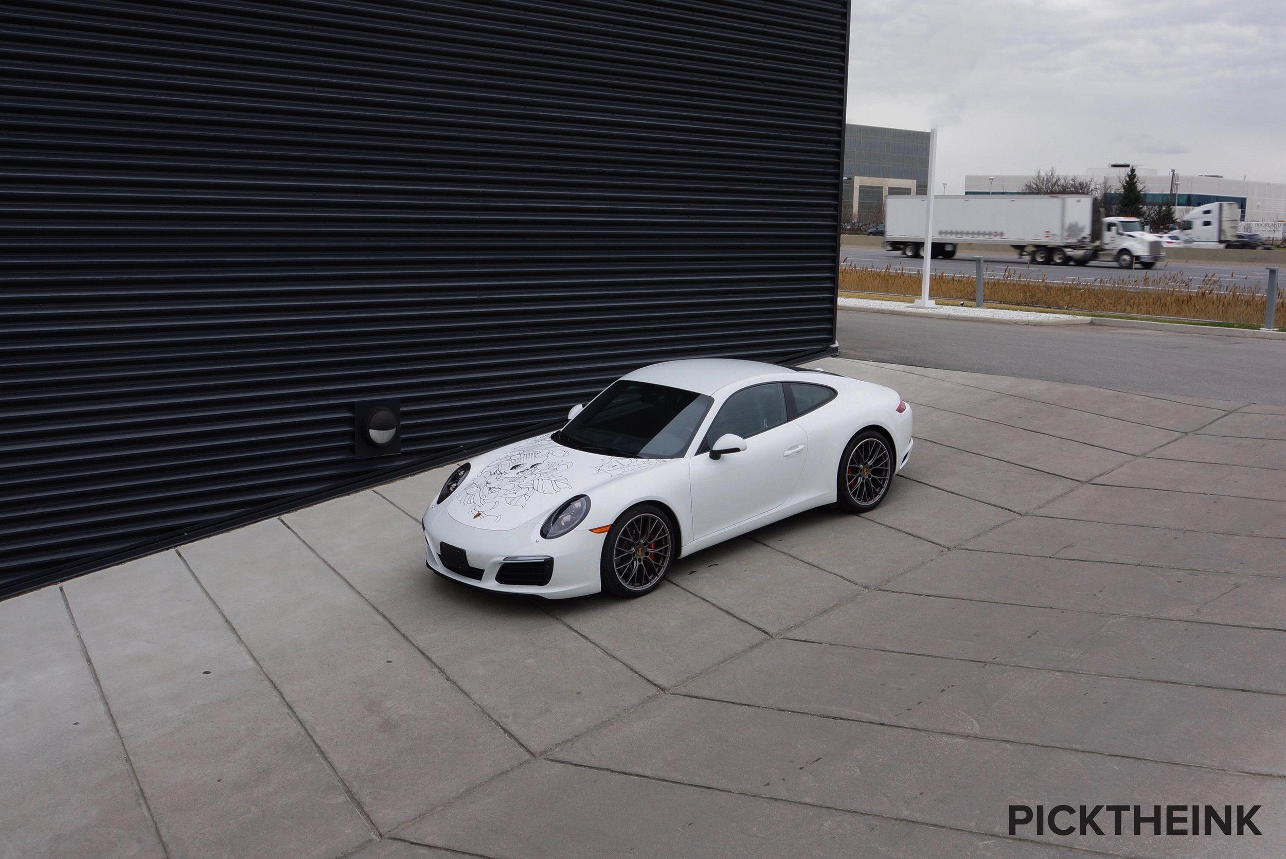 The white Porsche 911